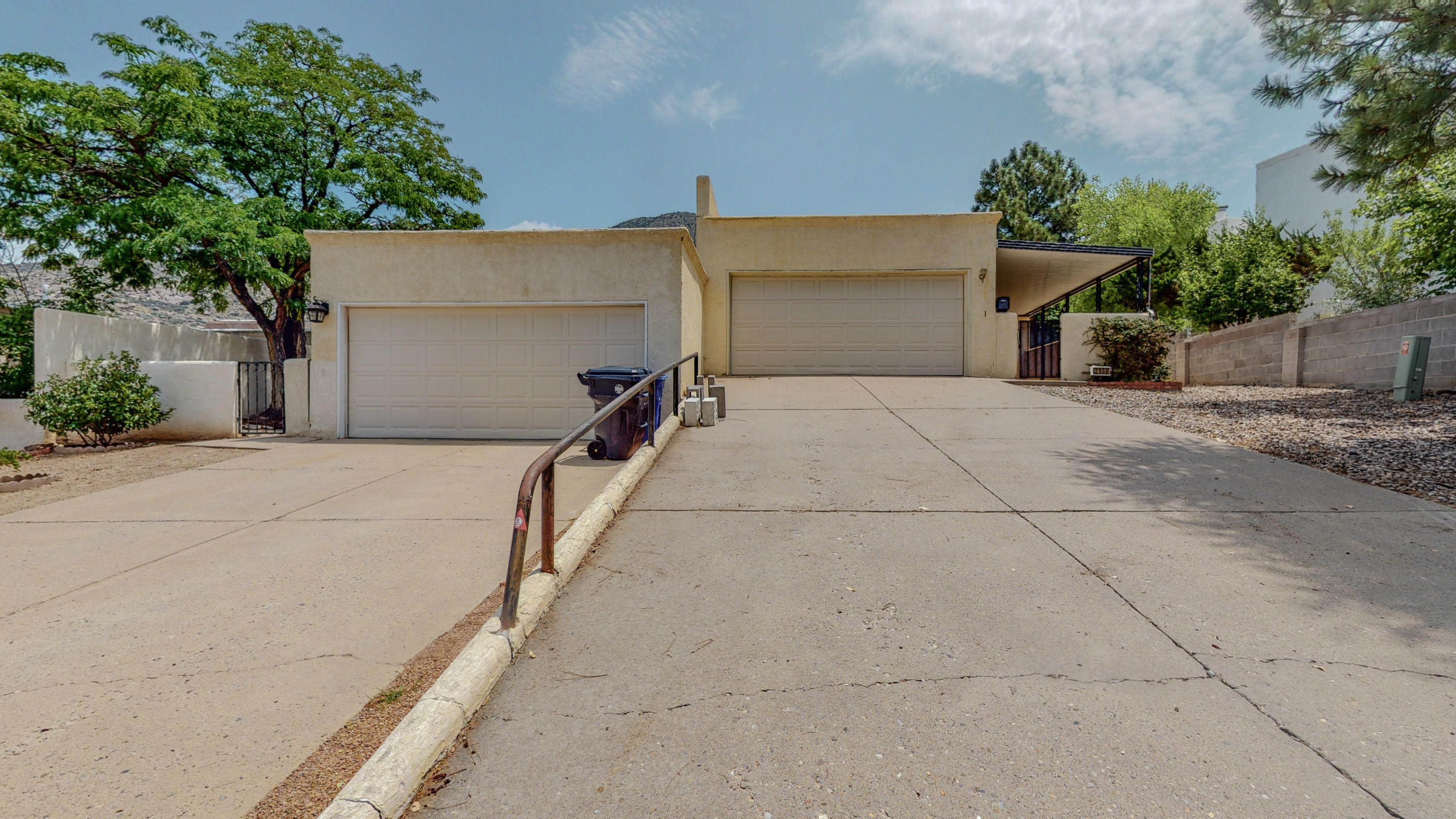 Great opportunity east of Tramway!  End unit  on cul de sac with NO HOA. Covered front patio, backyard access to fully fenced yard with up close mountain views.   Just steps from Sandia hiking trails.