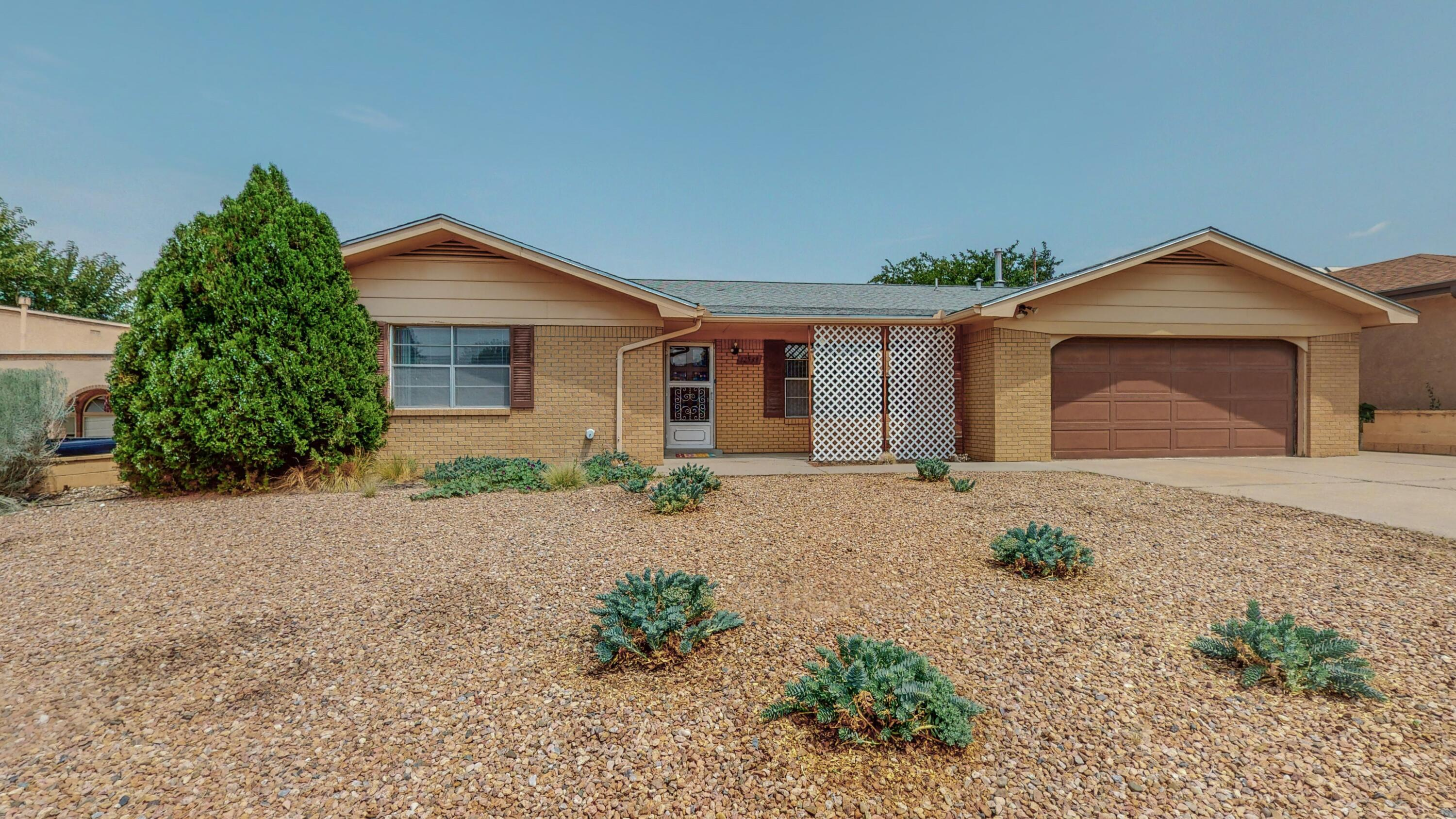 This wonderful home is just waiting for a new owner to come in and make it their own.  There is plenty of natural light with a wonderful flow and two living areas. The kitchen is large and features a breakfast nook overlooking the large backyard.  From the covered patio you have a view of the mountains and a clean slate to landscape to your liking. Centrally located and priced to sell - schedule your showing before it is gone!