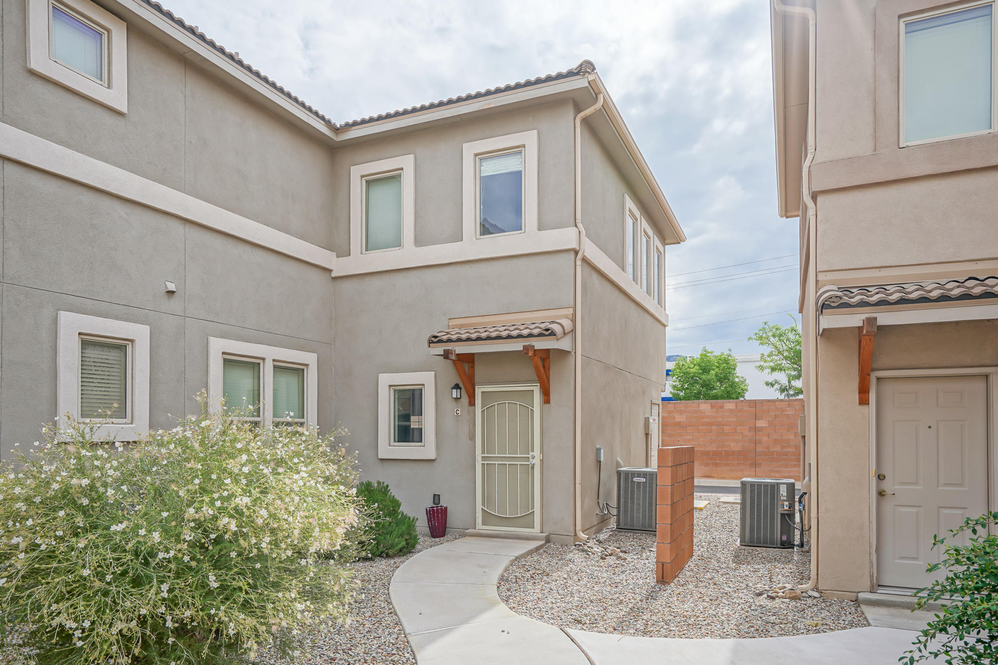 Must see Townhome located in the gated Presidio community. Open concept floorplan with raised ceiling and lot of natural light. Beautiful Sandia Mountain views from the private balcony. Stunning kitchen with dark cabinets, Corian countertops, Kitchen island with room for seating, under-mount sink, tile backsplash, and gas range! The owner's suite features a huge walk-in closet, dual sinks, and a large shower/tub. Refrigerated Air. HOA covers the exterior of the building, common areas, landscaping, and clubhouse, which features a fitness center, entertaining space, BBQ, and playground. Close to Restaurants, Shopping, Quick access to I-40 and Kirtland Air Force Base! More to come, including photos and a virtual walkthrough tour!