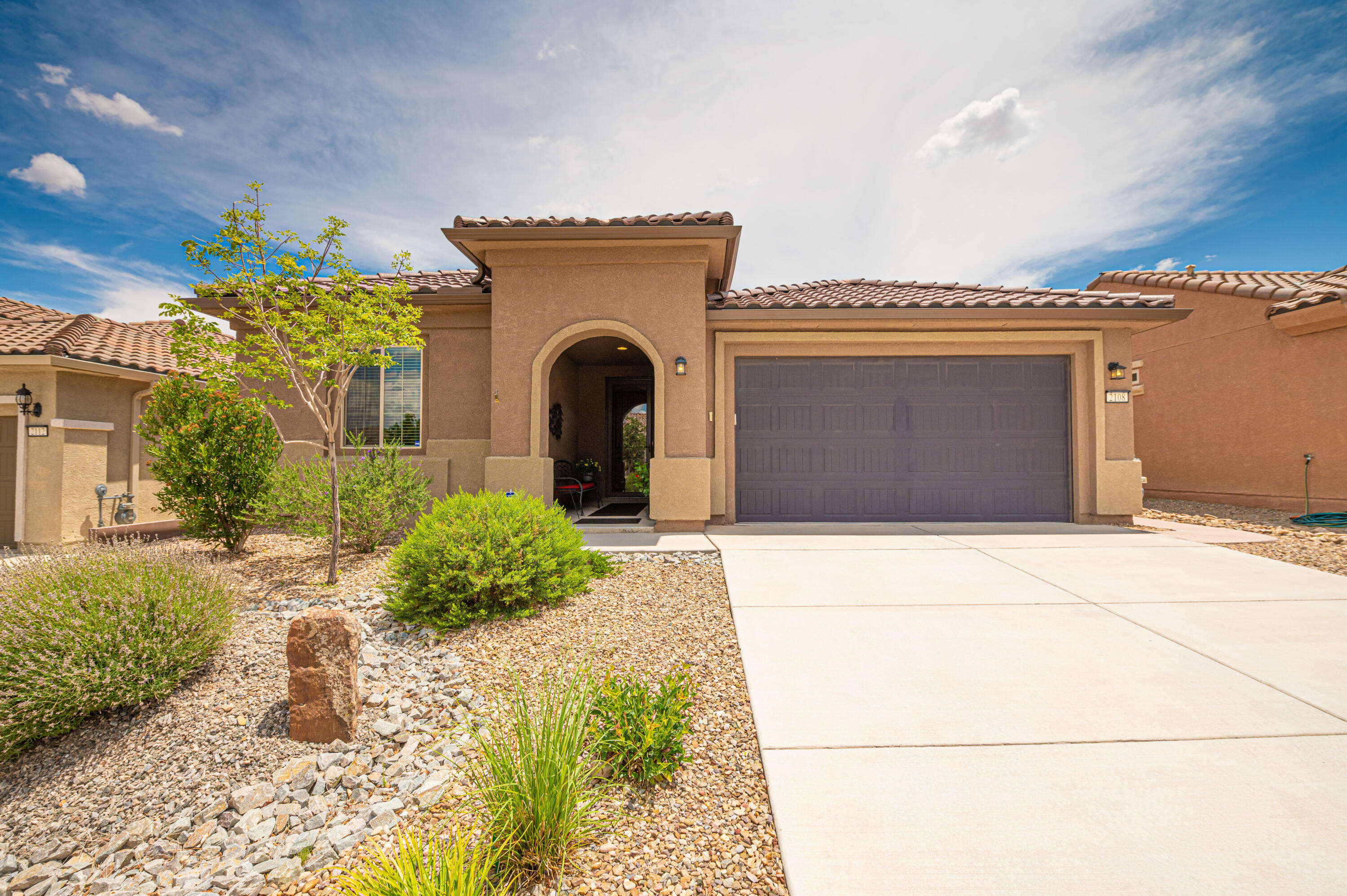 Gorgeous Home built on a Premium View Lot in the Exclusive Del Webb 55+ Community! This 2035 SF 'Preserve' Model home was built in 2017 and has PANORAMIC VIEWS OF THE CITY, SANDIA'S AND MONZANO MOUNTAINS!! Views are from the kitchen, dining, living room, master suite, back patio/yard and will never be obstructed!! Home has 2 BR's plus an office w/French Doors, a beautiful kitchen open to Great Room, large island, gorgeous Quartz Counter-tops, large pantry, gas cook-top, SS appliances, Gas Log FP, Dining Room!! 2 Car Garage has 4FT Extension, Epoxy Floor & extra storage space!! Expanded Laundry Room w/Mud Sink, Nice Barn Door too & W/D stay!  The BEAUTIFUL custom backyard has an outdoor kitchen (can be removed or easily moved), GAS FP! Enjoy Tennis, Pickle Ball, Salt Water Pool, Gym, etc!!