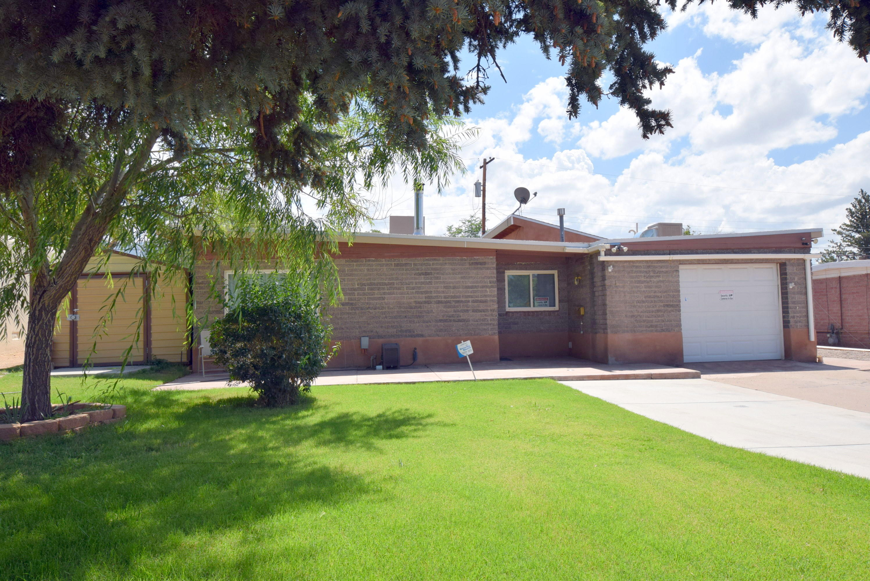 New roof7/21!. Remodeled kitchen with granite counter, bathrooms, additional family room with wood burning stove. Master bedroom is enlarge by opening up to one of the bedrooms. Lot's of possibilities for easy bedroom reconfiguration if you want 3 or 4 or even 5 bedrooms. Currently the office is off the front living area. Could be an office or nursey or even a art studio.  Family room with wood burning / pellet stove, opens to backyard with covered patio, fountain, gazebo, dog run and garden area, with storage. Living room has space for  wood burning stove with capped chimney and reinforced floor. Partially finished garage with laminate flooring, and cooling and work benches and TV conveys.