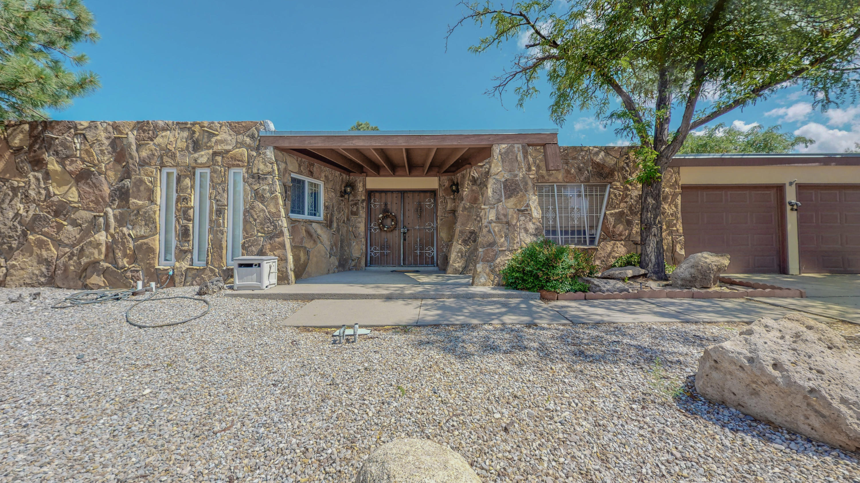 **Open House Sun 8/1 from 1pm-3pm**One of a kind home. This single level 4 bedroom, 2 living areas, 2 full baths  Mid-Century modern home is a rare find. Close to a huge park, rock exterior, cylinder shaped family room,   with a very generously sized backyard makes this a terrific find.  Separate dining room connected to the kitchen makes entertaining fun and easy. Come grab this one it won't last long. 2 car garage. Absolutely fantastic location close to I-40, Kirtland AFB, Retail and Restaurants.