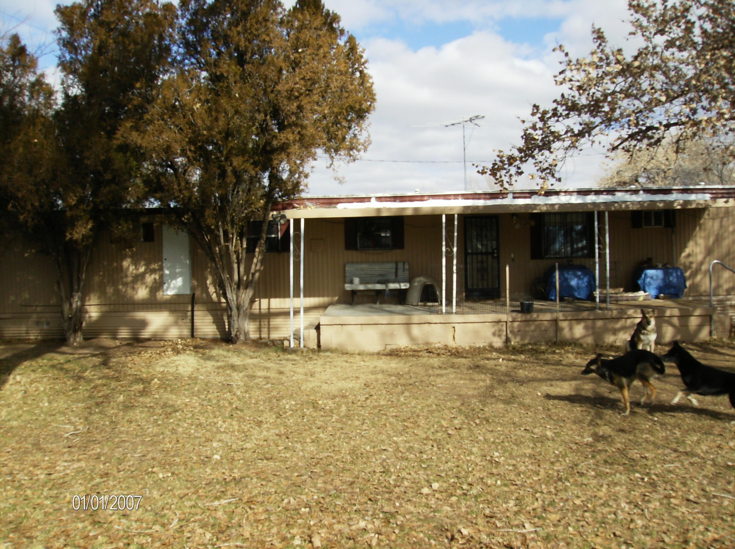 This listing is not about the manufactured home but the great property, it's location and area.  The home is a single wide that has been updated and well maintained.  The property has a big yard with a steel 20x24 garage, corral and  14x16 work shop with electric power.  Far enough from the BIG city noise but easy access to shopping and entertainment.  Drive by the property and get the comfortable feel of the area before you call the Seller to visit.
