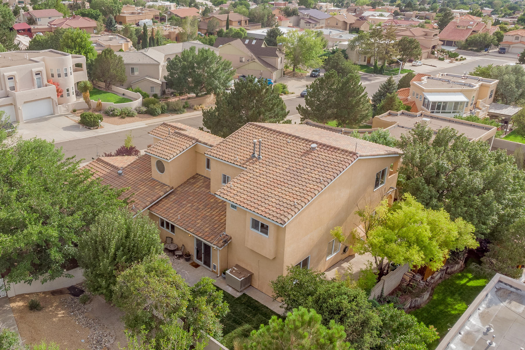 Stunning  Custom Mediterranean on 1/4 acre with spectacular city  light views! Located in the Foothills proximate to Embudo Canyon Spring & Hiking Trails - this gorgeous home is less than 6 miles to Sandia Labs. Enjoy balloons, sunsets & city lights while relaxing in the hot tub on the Owners Suite Balcony. Perfect home for entertaining featuring large rooms & outdoor spaces that can be configured to suit your lifestyle. Chef's gourmet kitchen with granite counters, wolf gas cooktop & ample pantry space. Elegant travertine gas log fireplace. Master bath features a jetted tub, separate shower, antique dresser style vanity & bombe mirrors. Outdoors is fully landscaped with automated sprinklers, real grass, fountains, arches, patios, & 25+ rose bushes.  Pre-inspected & repairs made.