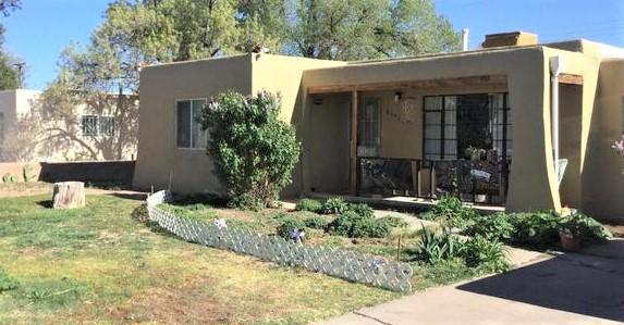 Beautiful 4 bedroom 1 3/4 bath home features lots of natural light, hardwood floors, updated 200 amp electrical, built in cabinets covered front porch, large patio in the backyard and storage shed. All close to UNM & Nob Hill, beautiful parks nearby, restaraunts, coffee shop, A must see!