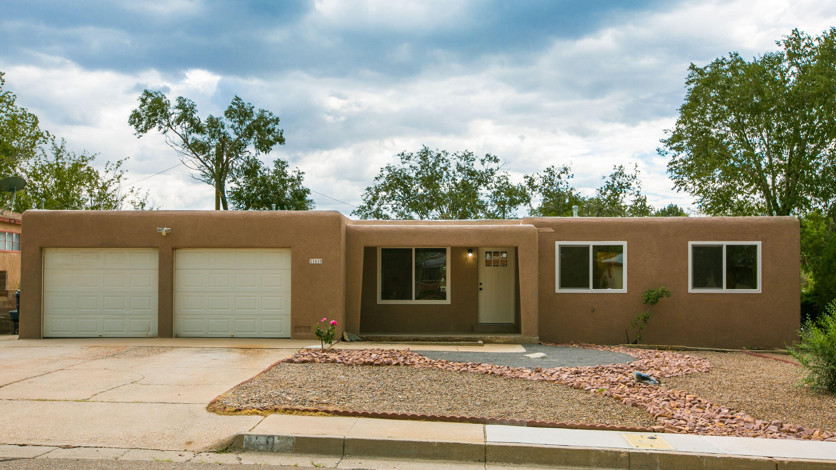 Don't miss this beautifully remodeled home in the desirable NE heights neighborhood of Snowheights.   Walk up to a charming front porch with an extra-large picture window.  Inside you have 2 large living areas, an open and spacious kitchen, built in book shelves and a rock fireplace.   Updates all done in 2021 include; new luxury vinyl flooring and tile throughout (no carpet), new roof, new furnace, new refrigerated air, and mini-split , new windows, stainless steel appliances, butcher block counter tops, and a freshly xeriscaped front yard.