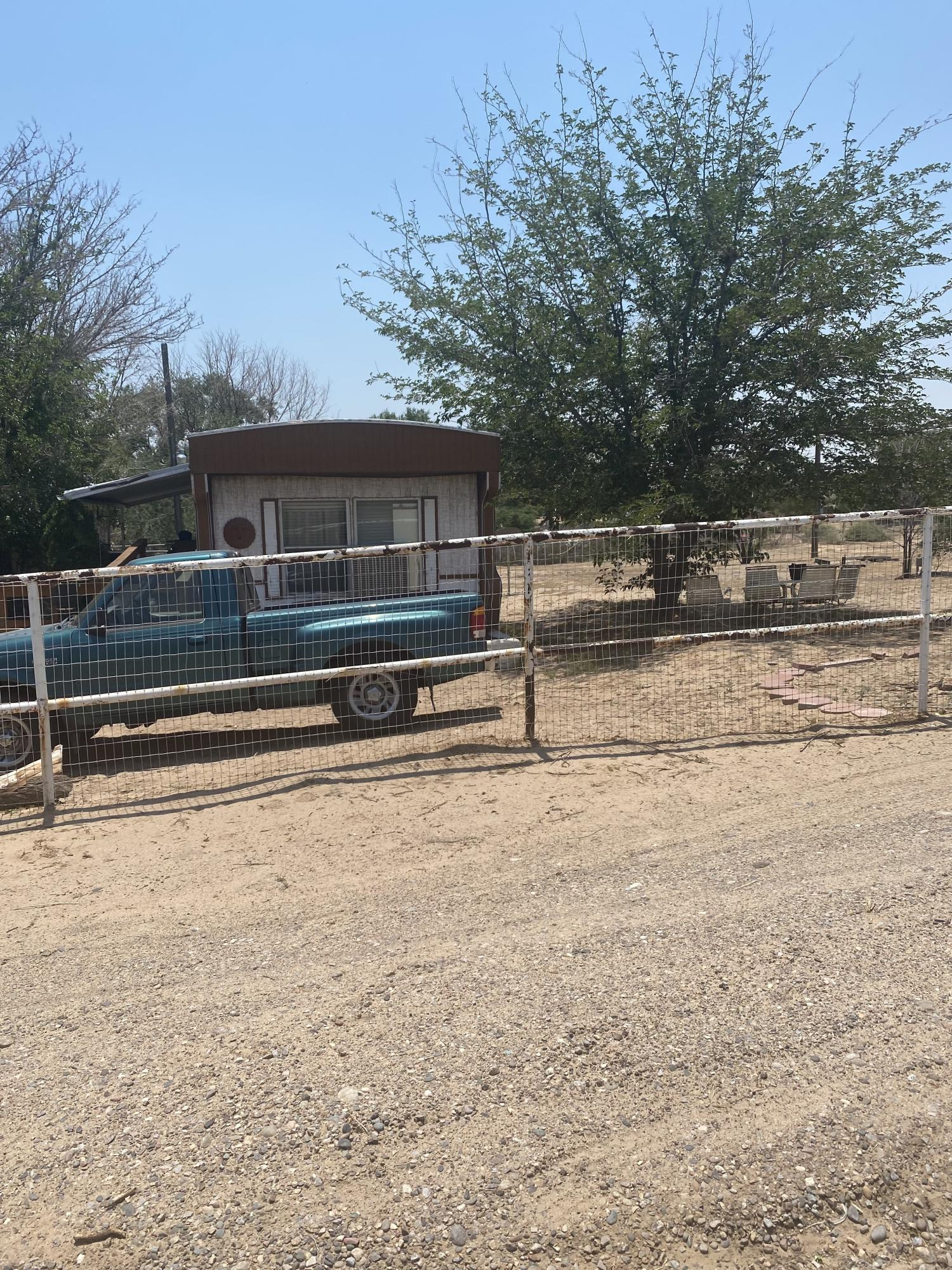 Move in ready, two bedroom, two bath property has a large living area/ dinning room.  Great size lot 0.750 AC.