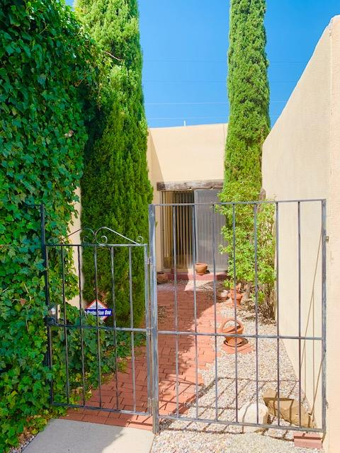 2BD 2BA Pueblo Style Patio Home For Sale In the Foothills! Close and easy access to Tramway. Home has updated kitchen, all black appliances included, granite counter tops, and stainless steel fridge. Breakfast nook has slider to open up to the private/gated front patio. Spacious Living Room has high vaulted ceilings and kiva styled fireplace. Wood Beamed ceilings adds a lot of character and charm. Primary Bedroom also has High Vaulted Ceilings, private back yard access, plenty of closet space, and dressing area. Primary Bathroom has double vanity sink, culture marble counter tops and surrounds, with framed mirrors. Brand new flooring throughout. Beautiful Sandia Mountain Front Yard Views, and Backyard Sunsets await you in your new home.