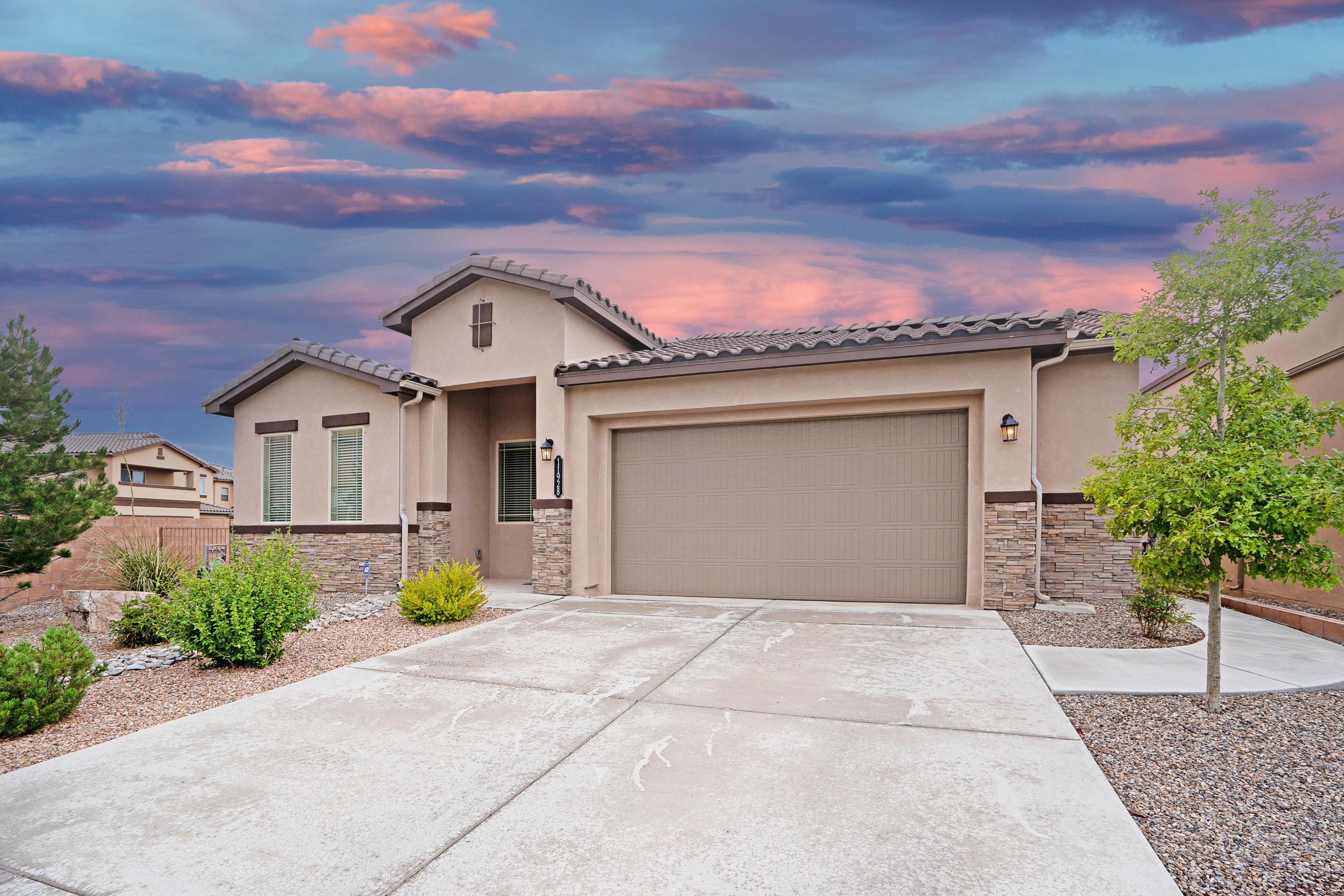 Welcome to this premium corner lot in the beautiful Volterra Neighborhood! Enter through the custom wood door to vaulted ceilings and impeccable tile floors. To the left is a large office or possible fourth bedroom. Down the hall are two bedrooms with their own bathroom, and the open kitchen has gorgeous floor to ceiling cabinetry, large granite island, and stainless steel appliances! The master bedroom is oversized and the spa-like master suite has a garden tub and amazing walk in closet. Laundry is in its own service room and garage is oversized! Entertain in the living room, cozy up next to the fireplace, and enjoy the sunsets and sunrises in the backyard under the covered patio. Astroturf and xeriscaping make maintenance a dream. Schedule a showing today!