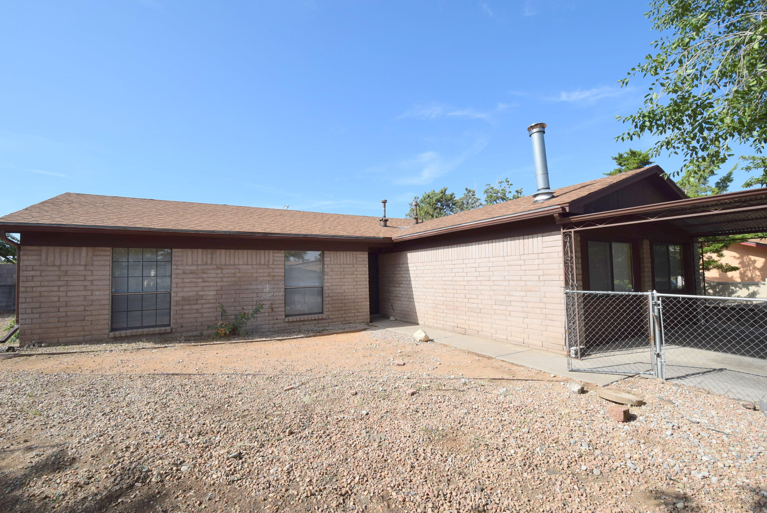 RV parking on the property.  Fully fenced in yard in far NE ABQ.  Inside has been fully renovated.  New stainless steel appliances.  Close distance to a city park, shopping, restaurants, public library,  conveniences, and trails.  Garage has been converted to a den.   2 car covered car port.