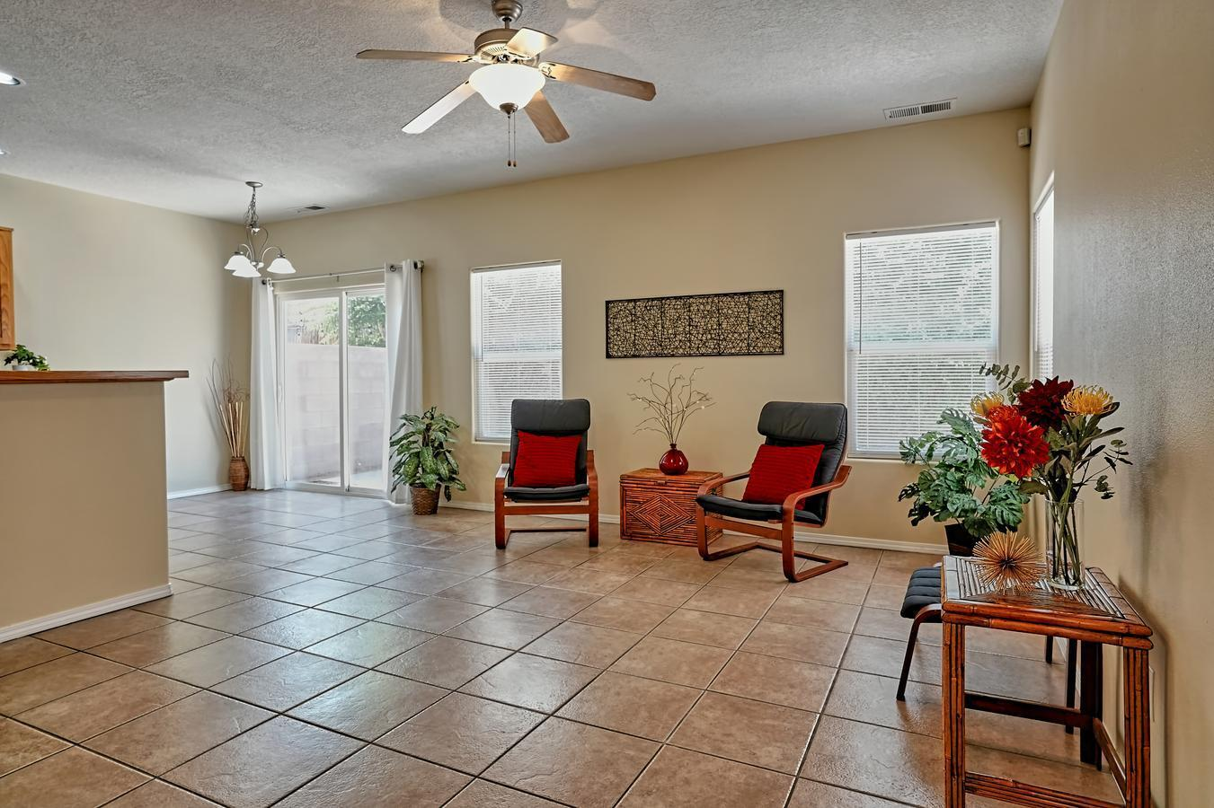 Wonderful light & bright townhome in UNM area.  3 bedrooms (huge primary bedroom with great walk-in closet), 2.5 baths, 2 car garage - built in 2004. Open floor plan with tile flooring throughout downstairs. New paint & carpet (6/21), New Stainless Steel Appliances (7/21), Refrig Air (combo unit) replaced 10/20, New Roof & Skylights (10/18), New Washer & Dryer (11/17), New Stucco (10/15), and more. Walk to UNM, UNMH, & Pres Hospital. Two minute walk to beautiful Spruce Park . . . a great place to live which is totally convenient to tons of cool places plus easy access to the freeway.  Was a good rental property for sellers. - if you're looking for a rental with a captive audience!  Take a look - and make an offer!