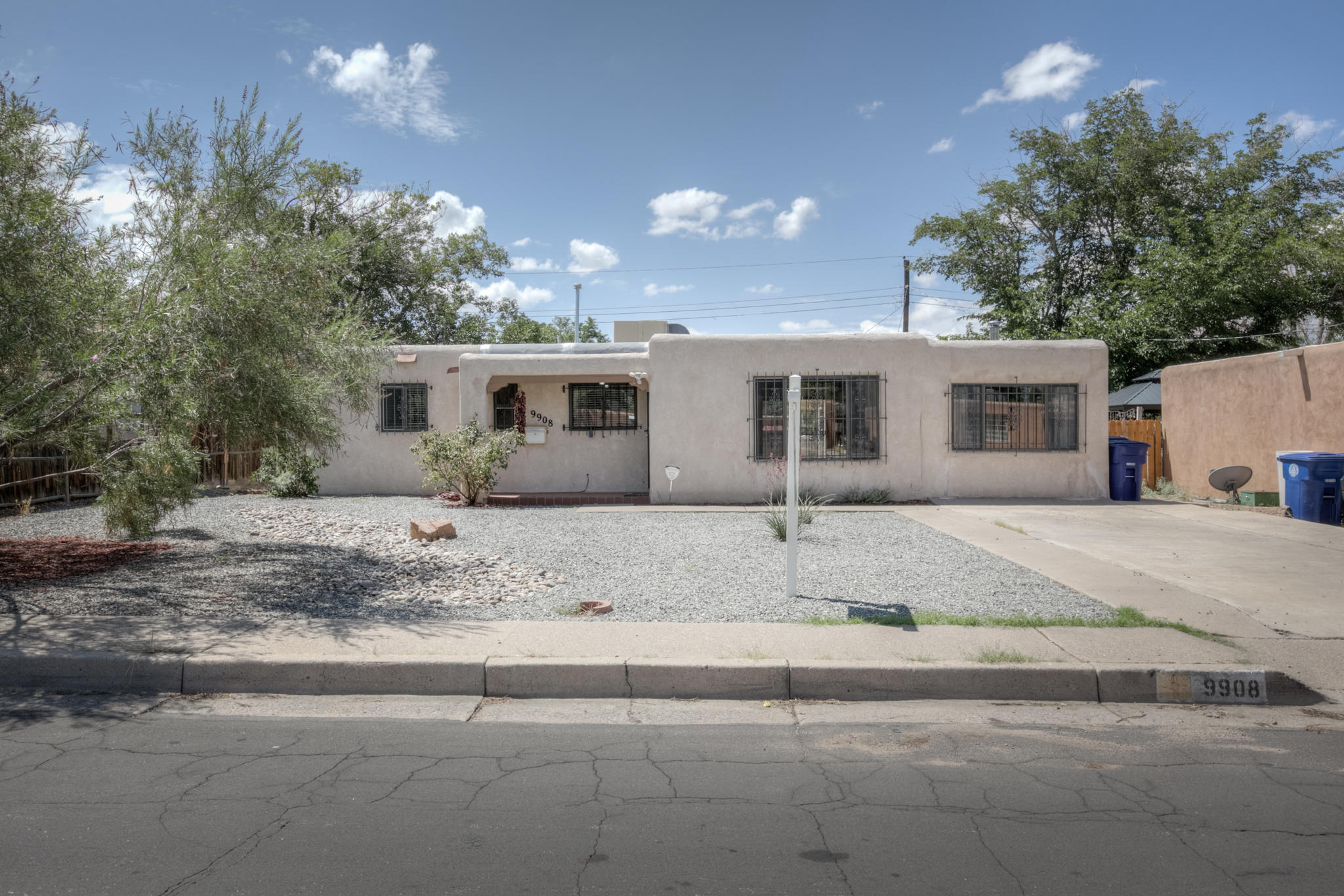 Lovely, light-filled 3 BR, 1 3/4 BA single-level home in a convenient NE location with easy access to the freeway, Kirtland AFB, shopping and restaurants. Spacious, updated kitchen with skylight, ample cabinet and counter space, and adjacent dining area. Large laundry/utility room with tons of storage.  Flex room could be 2nd living area, office or workout room. Cozy wood burning fireplace. Guest bath features  a charming claw foot bathtub . Nicely xeriscaped easy-care front yard and a large covered patio and back yard with storage shed.