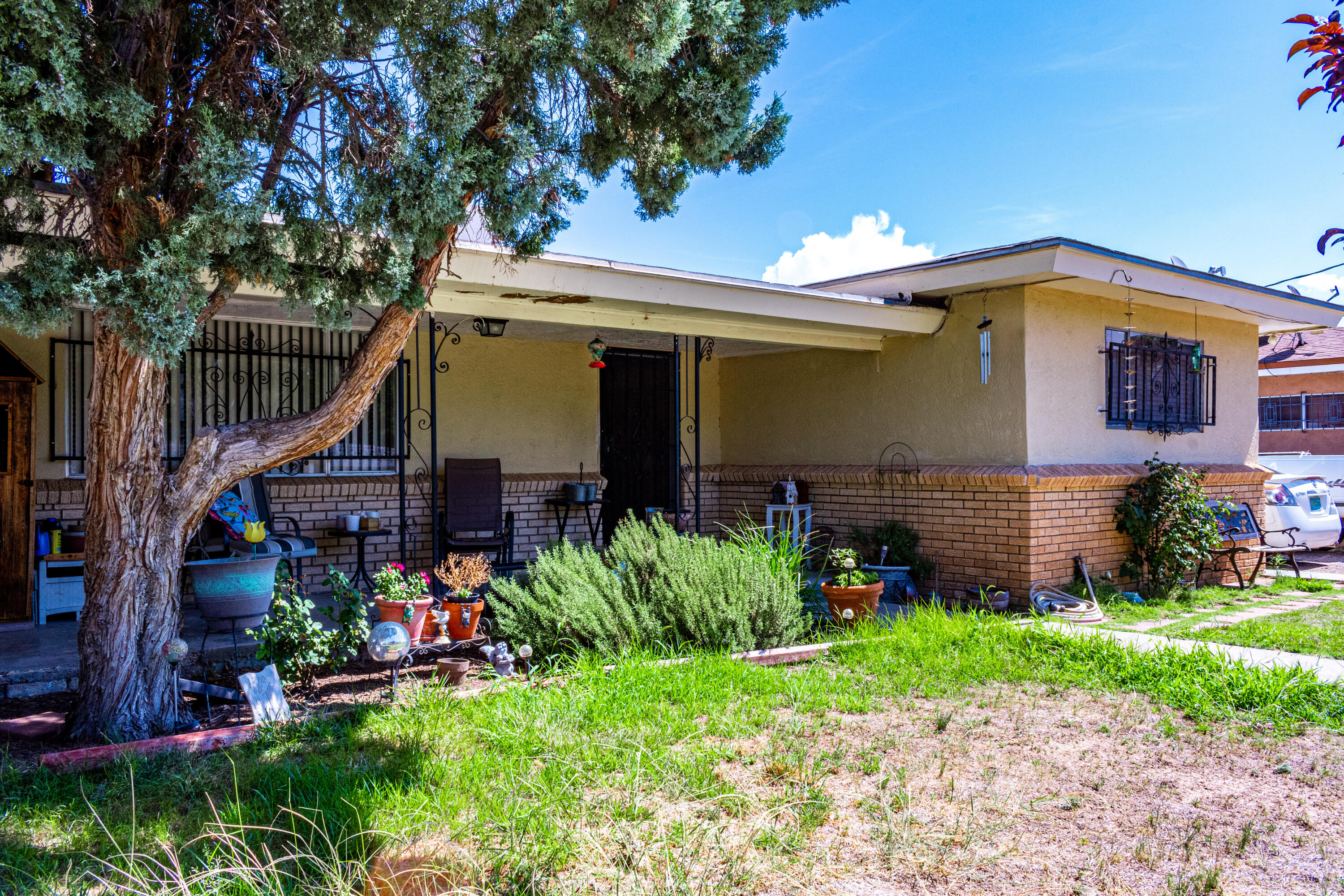 4 bedroom home with backyard access!  Carport, plenty of parking and storage in the back yard.  Primary bedroom is separated from the other bedrooms.