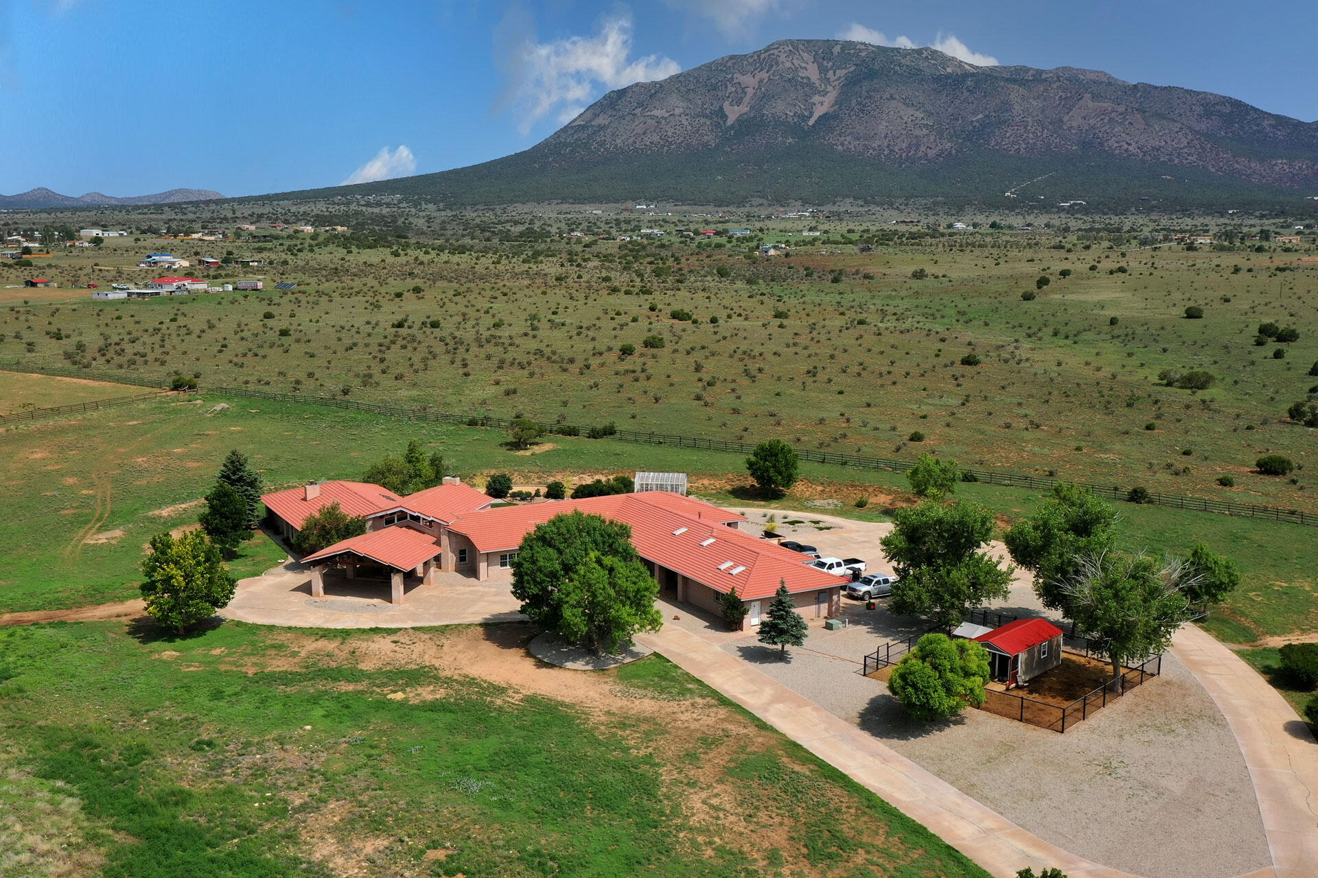 Where the mountains meet the plains. Hacienda de Caballo is a luxury equestrian estate ideal for the horse hobbyist or professional seeking a new ranch for their equestrian operations. A grand main hacienda with a spacious owner's ensuite plus 4 guest ensuites enjoys endless views and fine living. Two 2 bed/1 bath guest casitas are ideal for guests, staff, trainers or rental income. All 79.7 acres are fenced and cross fenced. Main barn has 4 large stalls plus tack, storage, vet stock & office/lounge. Lower & West barn offer more stalls & storage. Two pasture run-ins, too. Plus hay barn, shop, RV/Tractor garages, irrigation well with 10 ac/ft water rights & 3k water tank. EZ access to ABQ or Santa Fe plus close to I-40 for interstate travel. Breeches or chaps, you'll love it here!