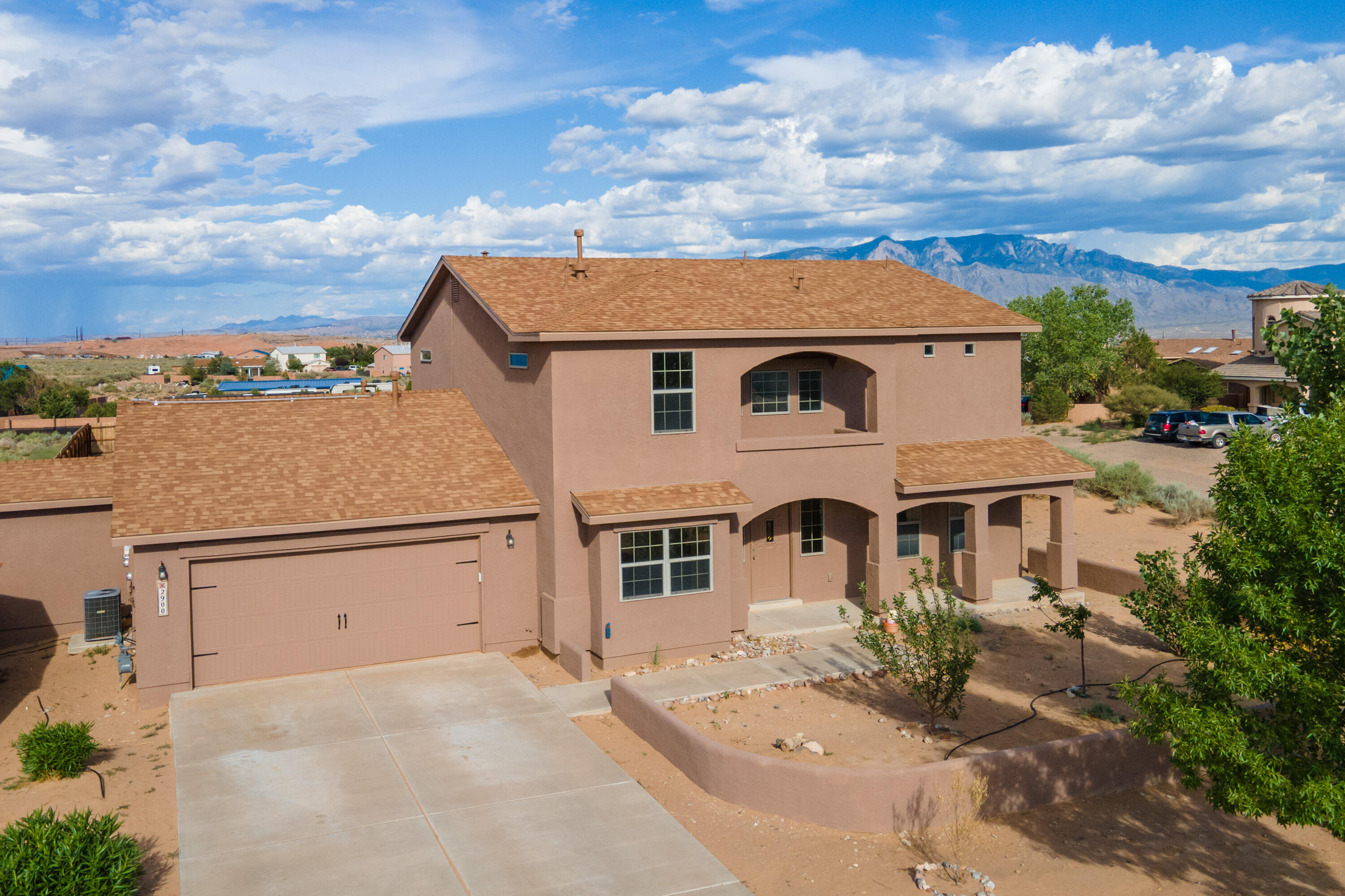 A Must See 4 possible 5 bedroom, 3 bath 2800+ sqft home in near Cleveland HS. Open floor plan formal living room and oversized family room. Enjoy the morning sunrise or sunsets of the Sandia Mts view from the Master Bedroom balcony. w/double sinks, separate shower, jetted tub and large walk-in closet Oversized 1.32 acres corner lot that has plenty of room to keep a horse happy and don't miss the separate room off the garage that could be either an office for a quick telecommute or a tucked away craft room. Many possibilities for this unique home. Almost forgot to mention the new roof in 2020.  Come see it today may not be here long.