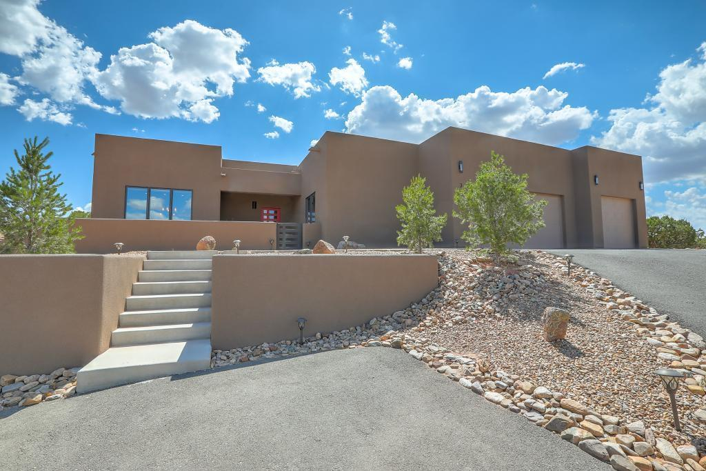Gorgeous contemporary custom home on 360 degree view lot. Stunning mountain views from walled backyard, living room and kitchen. Sunset view from master, second bedroom and walled backyard. Chef's kitchen features McCoy custom cabinets, granite counters and island, glass and metal backsplash, breakfast bar, Subzero refrigerator, Wolf gas range, Asko dishwasher and large pantry. Custom touches include unique light fixtures, custom tongue-and-groove ceiling in great room, custom wood burning fireplace, wood-look tile throughout and Shaw Caress carpet in bedrooms. Master suite has large walk in closet with built-in shelving and chest of drawers, and the spa-like en-suite bath features a dual vanity, large jetted tub and separate shower. This one will go fast!