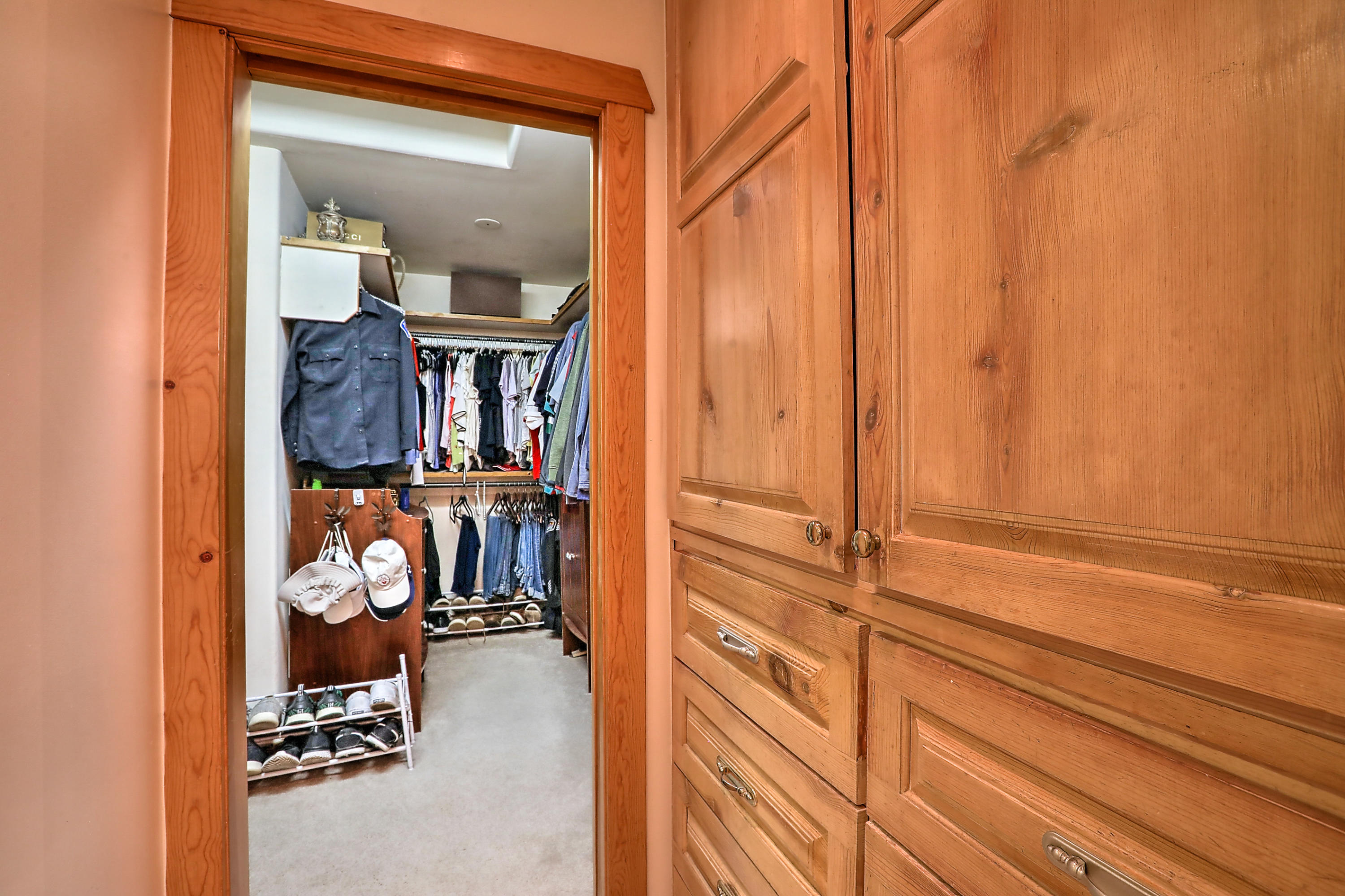 Elegant North Valley Southwestern Pueblo style home with 4 bedrooms plus office, 3 bath, 3 car garage near Rio Grande Blvd. and Alameda  tucked away in Rio Grande Estates. You'll find an oversized one plus acre lot with plenty of room to play or for a new owner to add a swimming pool. Beautiful design with architectural features galore. Adobe accents with latilla ceiling treatment, saltillo flooring and wood beams and corbels.  Two custom kiva fireplaces and traditional tile throughout. Upstairs private balconies let you enjoy the views of Sandia Mountains. Beautiful views from the east facing home, and sunset views from the backyard patio. A separate smaller courtyard separates the outdoor living area from the larger backyard.