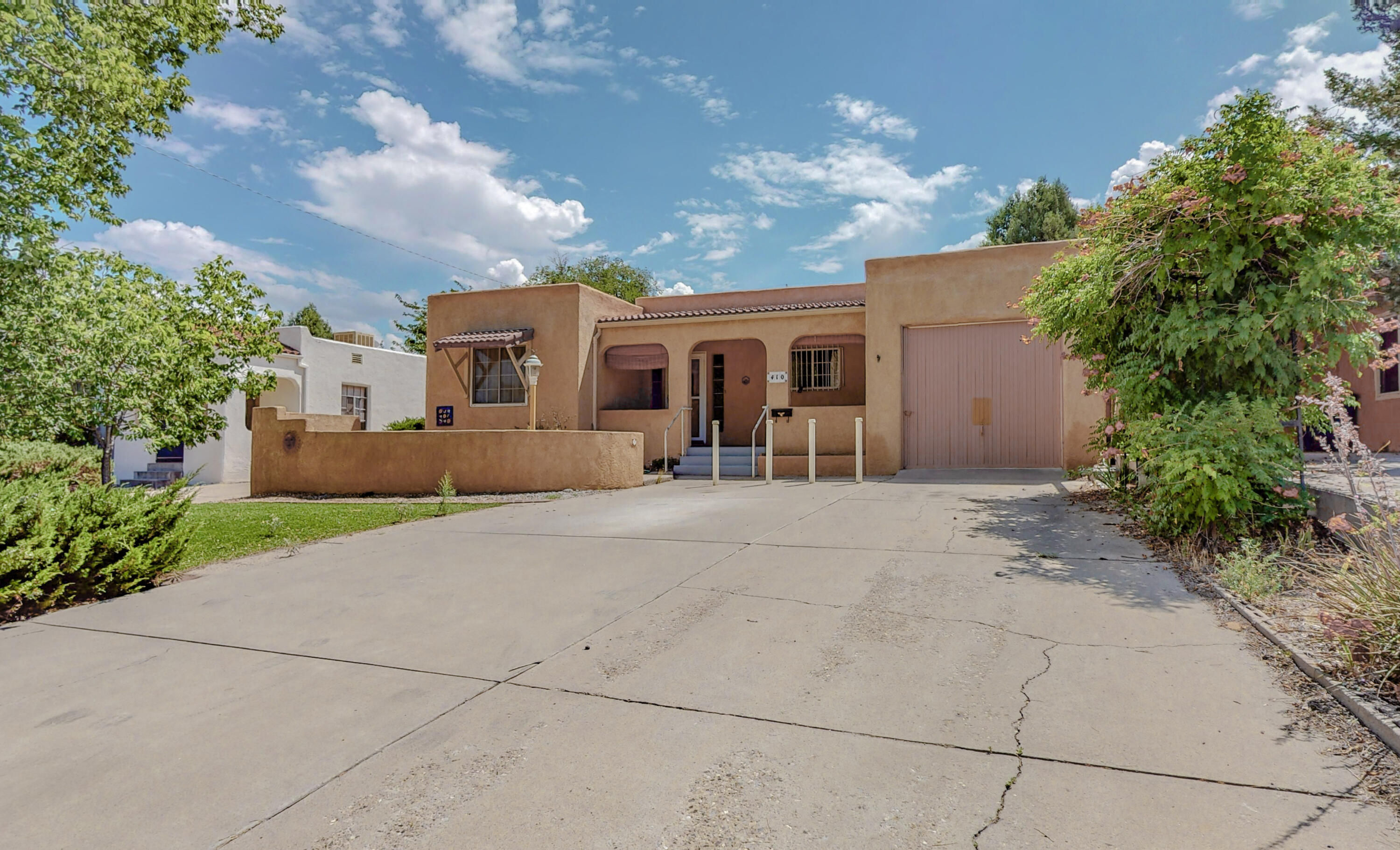 Immaculate Home in the University Area just minutes away from UNM, CNM restaurants and entertainment.  Featuring a 4 Car Garage set up that offers many uses and opportunities - home gym, workshop, storage, extra vehicle space, etc. 3 car garage is approx. 900/sf is heated includes a 1/2 bath and 220 electrical.  Recent Improvements include new roof 2019, A/C Replaced 2020, Refinished original Oak Hardwood floors. Floor plan features 2 separate living areas one with a wet bar for entertaining and flexibility.  Master Suite offers spacious 6x8 walk-in closet and dual vanity sinks.  Private covered patio accesses off family room and dining area.   Storage Room, Closet Space and Garage space make this a winning combo in the UNM area.  Call today to schedule your showing.