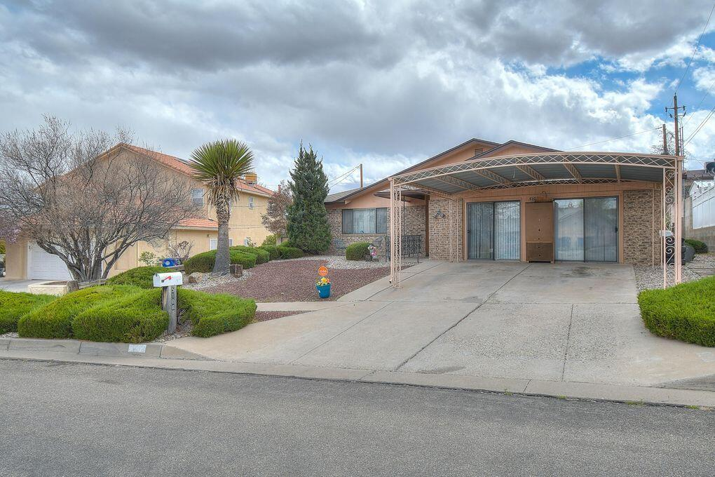 Beautiful brick home only 5 minutes away from downtown Albuquerque. This home is fully handicap accessible including brand new walk in high wall shower. All Kitchen Appliances EXCEPT for refrigerator are conveying. Amazing lawn in the backyard. Huge workshop in backyard equipped with heating and air. SELLING AS IS. *Sellers are requesting an occupancy agreement for 60 days past closing.*