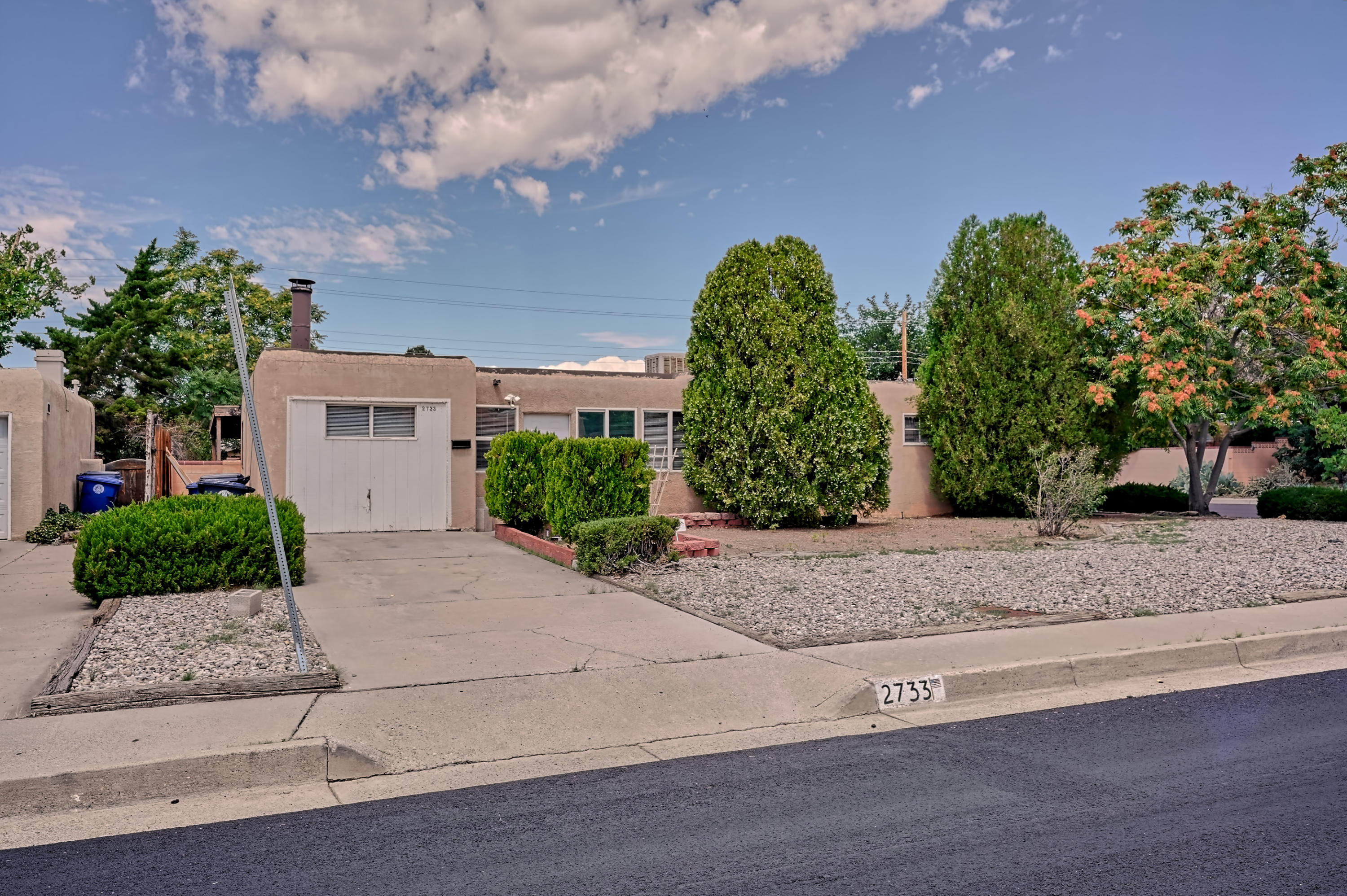 This home features original hard wood floors, updated kitchen appliances, a huge back yard and a detached two car garage. Located in the highly desirable Sandia High School district.  Sold as is. No post inspection repairs.