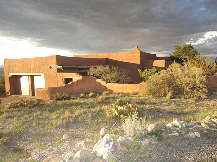 The Overlook Subdivision of the Placitas  Community.  breathtaking views from your backyard , rolling hills, distant mountain ranges. Pueblo style home saltillo tile and brick floors, vigas, large bookshelf in livingroom, 3 bedroom,2 full baths and oversized 2 car garage