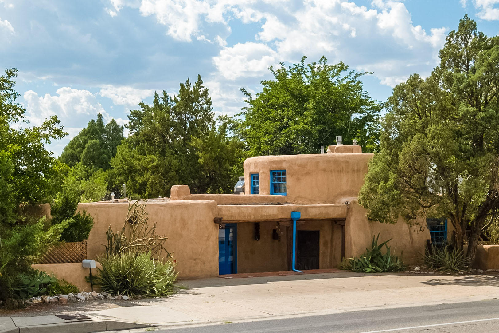 Fantastic Nob Hill location, close to food, shopping, entertainment, UNM, CNM, and hospitals. This wonderfully artistic home was constructed around a water tank from 1916. This home has classic charm mixed with modern amenities, to include a tankless water heater in the main house and the 400+ sf. Casita in the back of the home. There are numerous unique architectural details throughout the home. Artistic light features, nichos, Saltillo floors, and Vigas give this home a classic charm. The oversized lot features a garden area with fruit trees that is a rarity in such a centrally located property.There are also many parking options for those who like to entertain. Ample parking is in front of the property with access to the back yard located at the south of the home, as well as the alley