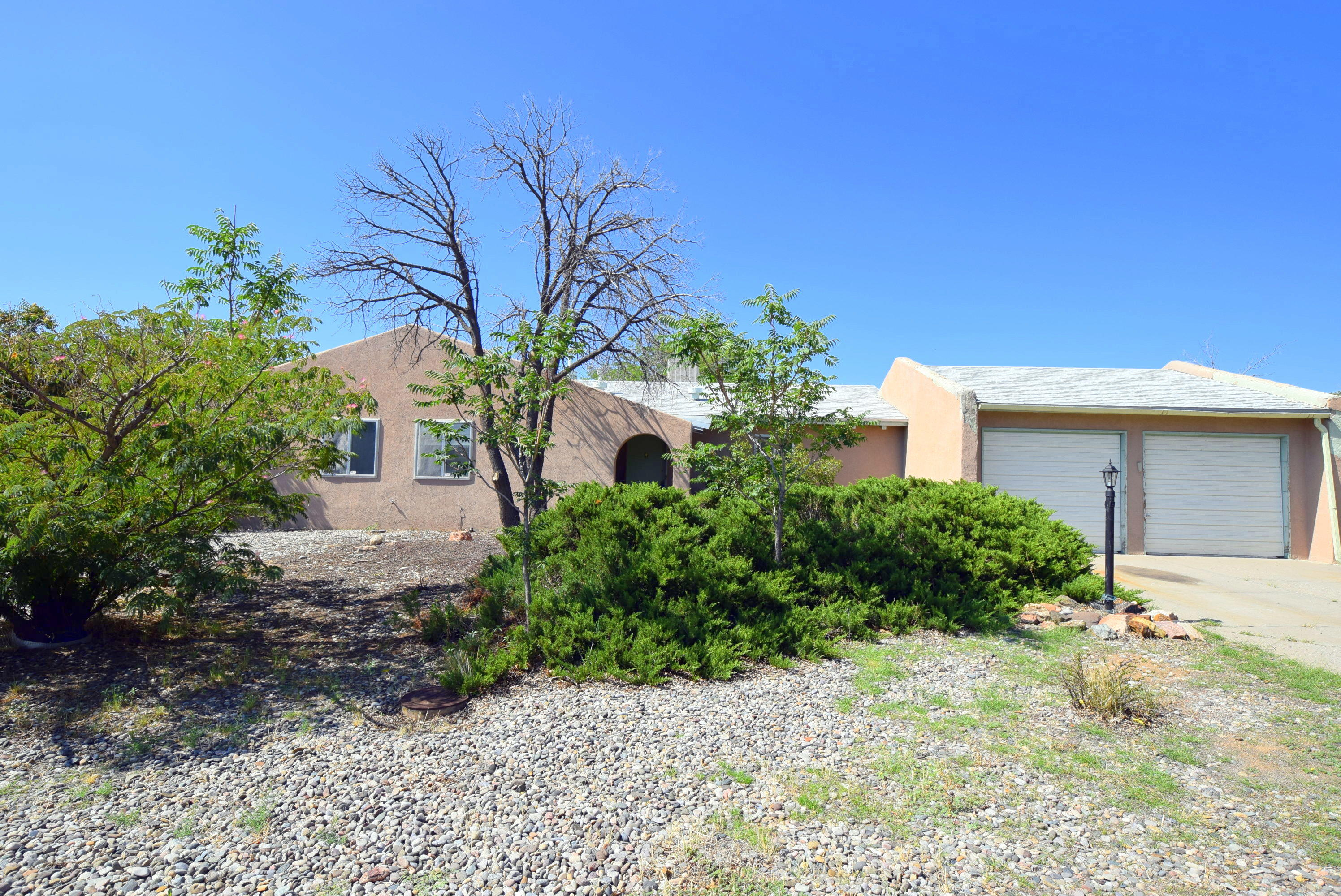 Great Deal on this starter home in Rio Rancho with unlimited potential.  Featuring 3 large bedrooms, updated kitchen, huge backyard, no HOA, single level living.  Conveniently located near shopping & dining.  Don't miss out on this excellent deal in Rio Rancho.