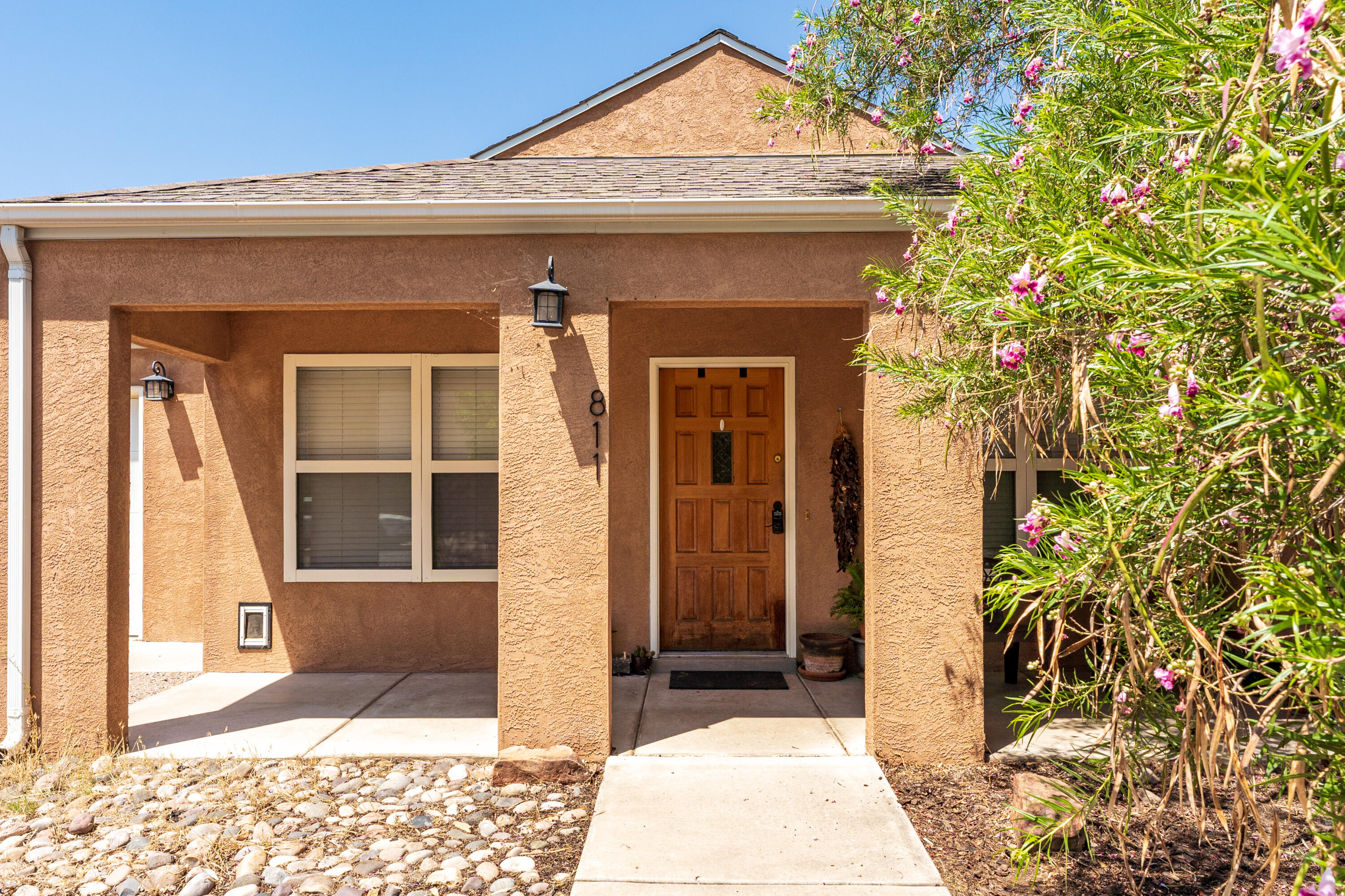 You don't want to miss this adorable Downtown gem! This home has cathedral ceilings with tons of natural light from large updated windows and skylights. The gas fireplace compliments the open layout with built-in shelves! The projector in the Master bedroom and all the appliances stay with the home!