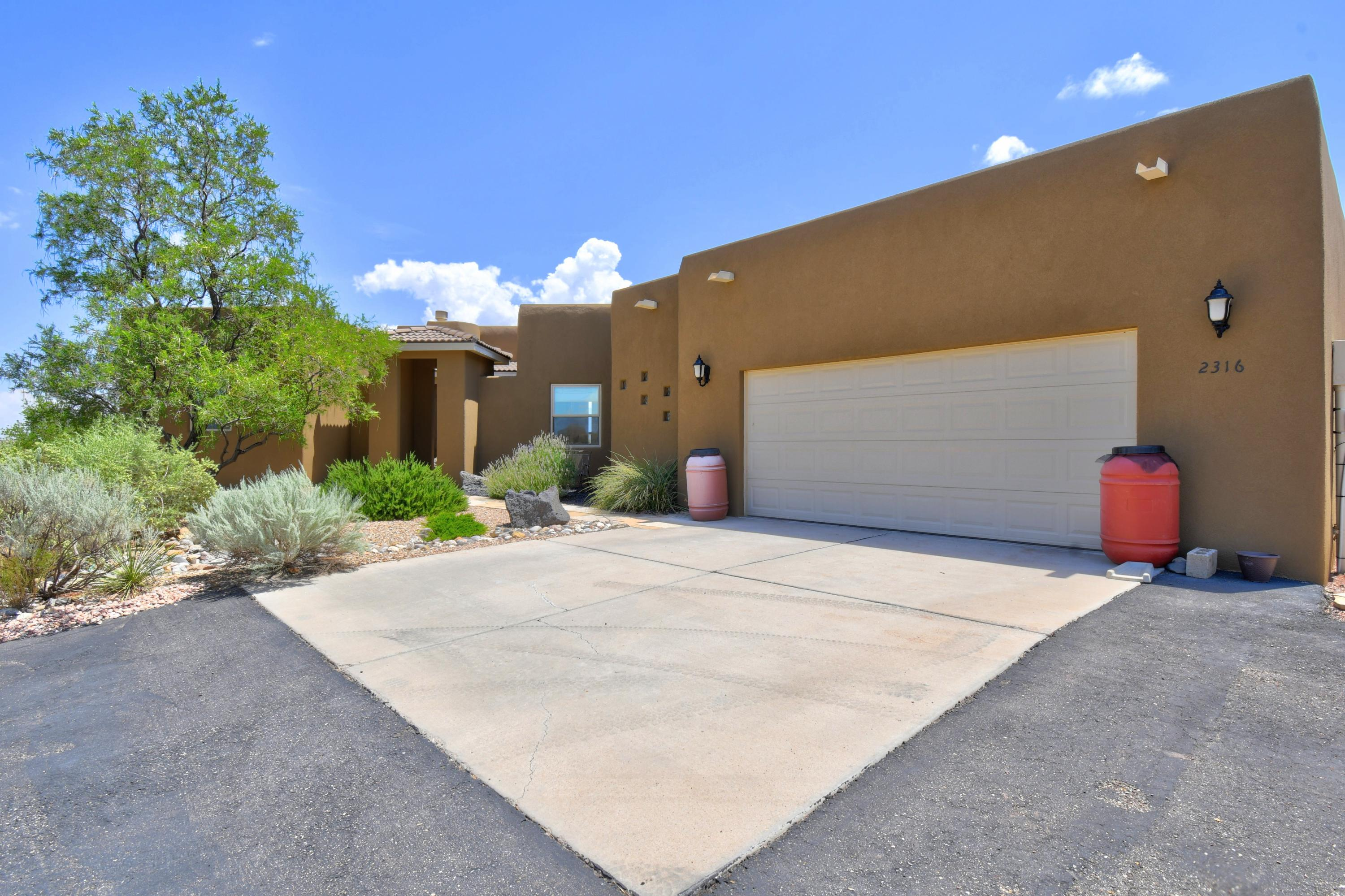 This Pristine Custom Ron Montoya Designed Home Features Breathtaking Sunrise & Sunset Views That Wow You! Enter Through the Vesibule To The Front Door. Enjoy The Great Room W/A Cozy Gas FP W/Stone Hearth, Large Tile Floors & Curved Window Wall. Spacious Kitchen W/Corner Walk-in Pantry, Window Over Sink, Granite Counters, Stone Tile Backsplash, 2 Yr Old Stainless DW, Large Bar Top For Every Day Use. Open To The Dining Area & Great Room. Pella Wood SGD to Covr'd Patio. Enter The Luxurious Master EnSuite Through French Doors, An Arched Opening Takes You To The Sleeping Quarters W/Wide Plank Wood Floors, Window Wall & Door to Covr'd Patio. Corner Jetted Garden Tub Separates Two Sinks & Vanity. Snail Tile Shower W/New Dual Shower Heads, Water Closet, Wood Pocket Door To The WIC & Linen Closet.