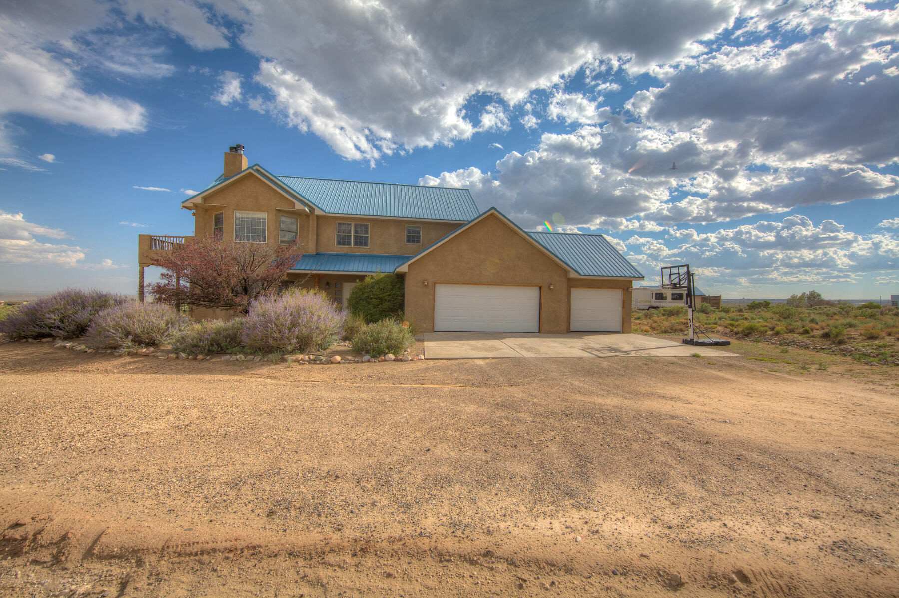 So hard to find in South Rio Rancho! This home features 5 true bedrooms, 2 living areas, 3 fireplaces, and a 3 car garage, all on a 1 acre lot with plenty of room for your extra vehicles or toys. You will also enjoy incredible mountain and city views from both levels. Lots of tile and wood flooring on the first floor, and stainless steel appliances with plenty of cabinet space in the expansive kitchen. The master bed has a cozy fireplace, a relaxing East facing balcony, and the master bath has dual sinks with a jetted tub and separate shower. Ceiling fans are in every room, and there is cool refrigerated air.