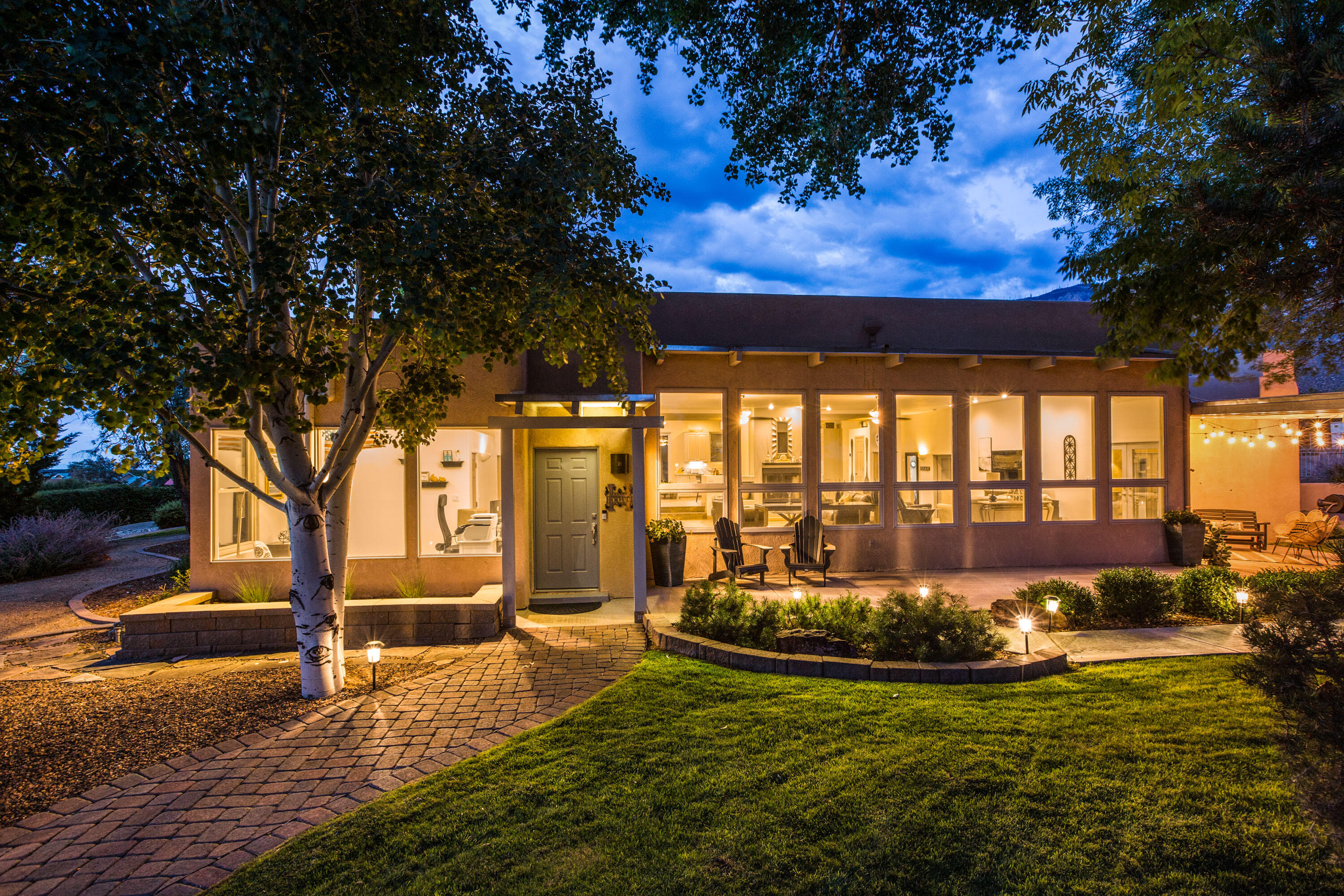 *Open House this Saturday 8/7 from 1pm-3pm and Sunday 8/8 from 12pm-3pm**This one-of-a-kind custom home located in North Albuquerque Acres is a rare gem.The home offers an  amazingly generous Great room as well as 4 bedrooms, 4 bathrooms, and an office.  The Primary suite is separate from the secondary rooms for added privacy.The office   offers a wall of windows showing off the spectacular Sandia Mountain views.  Also, offered are a 4-car garage (2-car garage is detached and 2-car garage is attached).  The yards both in the front and back of the home take full advantage  of the glorious Sandia Mountain views allowing you to take in the views wherever you chose to relax and take them in. Too many glorious attributes to name with this home. A definite must see, this won't last long!