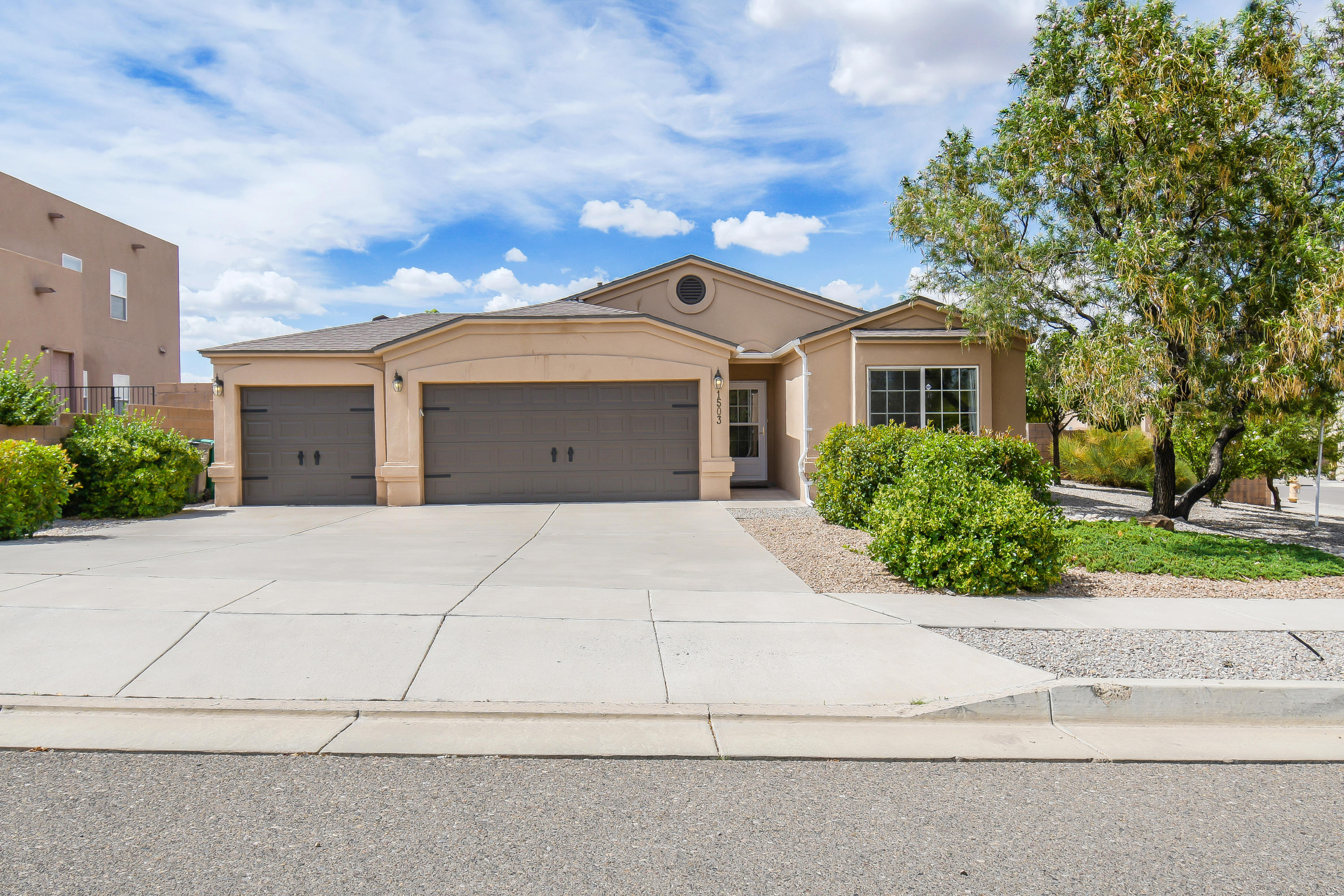 Picture the location of your next house, your new home: Rio Rancho. This Beautiful Spacious 1678 sq. ft. Single-Family Home built in 2006 in a corner lot contains 3 BR, 2 Baths with 3 car garage! Lots of updates in this bright and airy home. New roof installed last 2019 and the sun-filled home has tile throughout including the baseboard. The cozy family space has it's glass covered gas log fireplace perfect for relaxing and unwinding. Granite countertop accented with nice stone tilebacksplash, wooden cabinetry, pantry and appliances creating an incredible kitchen any Chef would approve. The walled backyard has covered patio and a storage shed with stucco and roof that matches the house perfect for entertaining. This prestigious home is a fabulous find and definitely not to be missed!