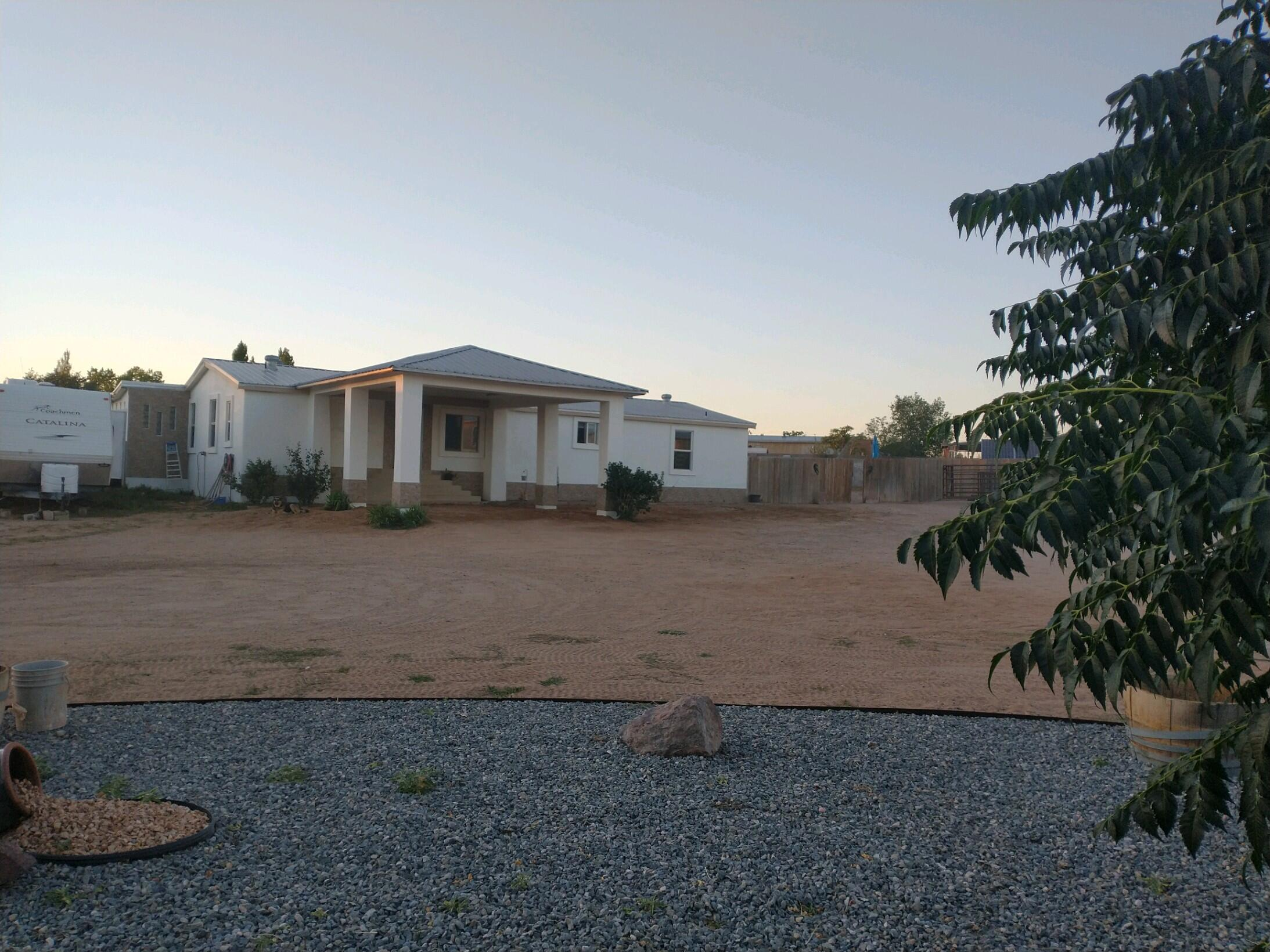 Amazing home fully remodeled that sits on a half acre lot with endless possibilities , rose bushes, fruit trees, Electric Service for your RV , Solar panels Also has a second living room or even a entertainment room !This home has so much to offer .Come checkout this property today.