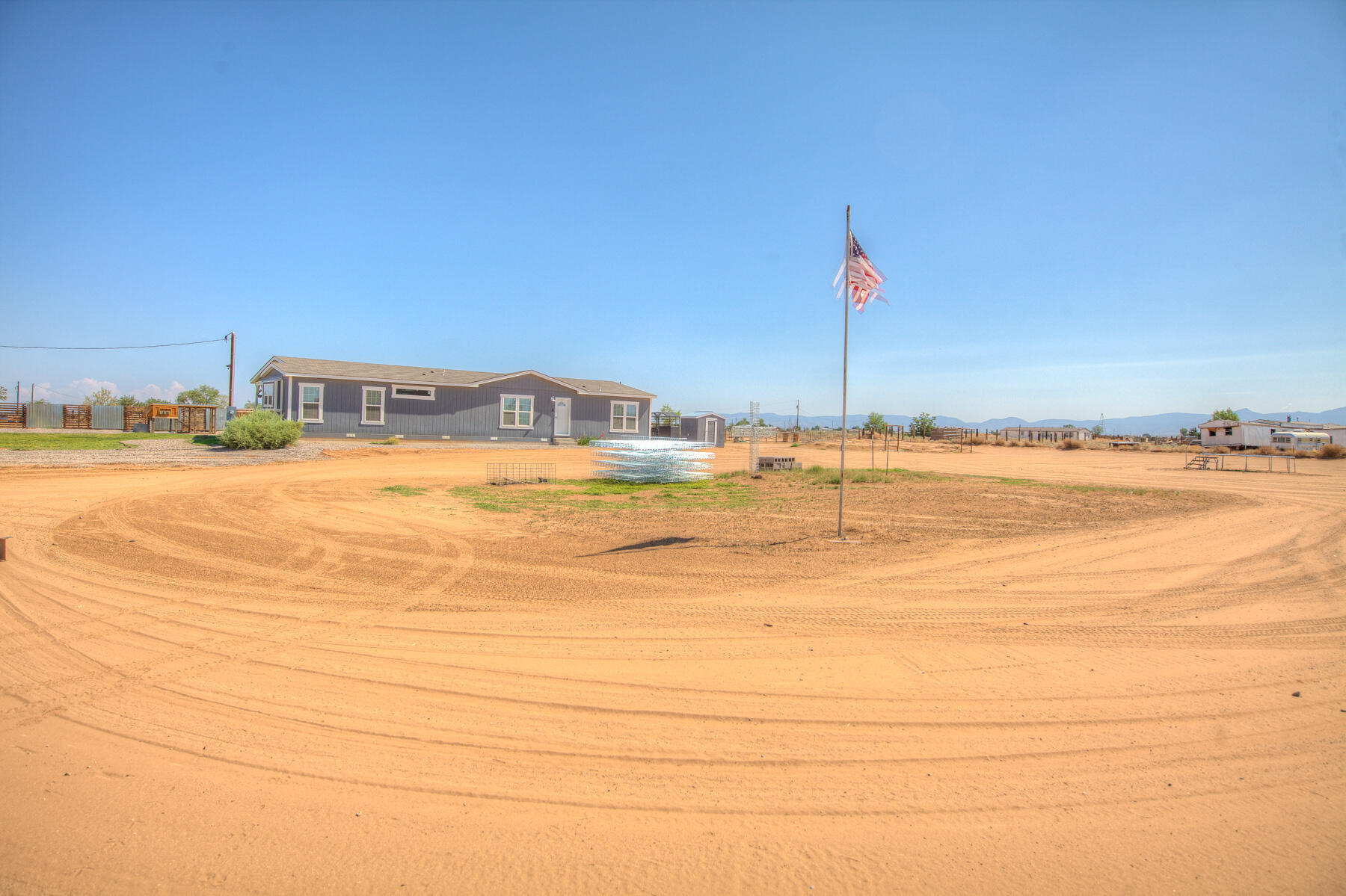 Enjoy this fully fenced and private with cattle gate at property entrance. Landscaped with a covered deck,custom chicken coops. Over sized large dog run.. Livestock pens a 16X32 cattle gate,2 pole barns a 16X16 and a 32X40 gate dual lofted barn. This home also has a new septic,New pump house plus storage. Home has recently had a new power pole installed by PNM. New refrigerated A/C. Inside enjoy the stylish Farm House look. Over sized owners suite with spa like bath with spa tub and seprate shower, private commode room.Split floor plan master is seprate from secondary bedrooms. All bedrooms have oversized closets.Large great room plus added family dining room.Oversized pantry and utility room.  Beautiful lighting package to include chandeliers and recessed lighting make this a must see..
