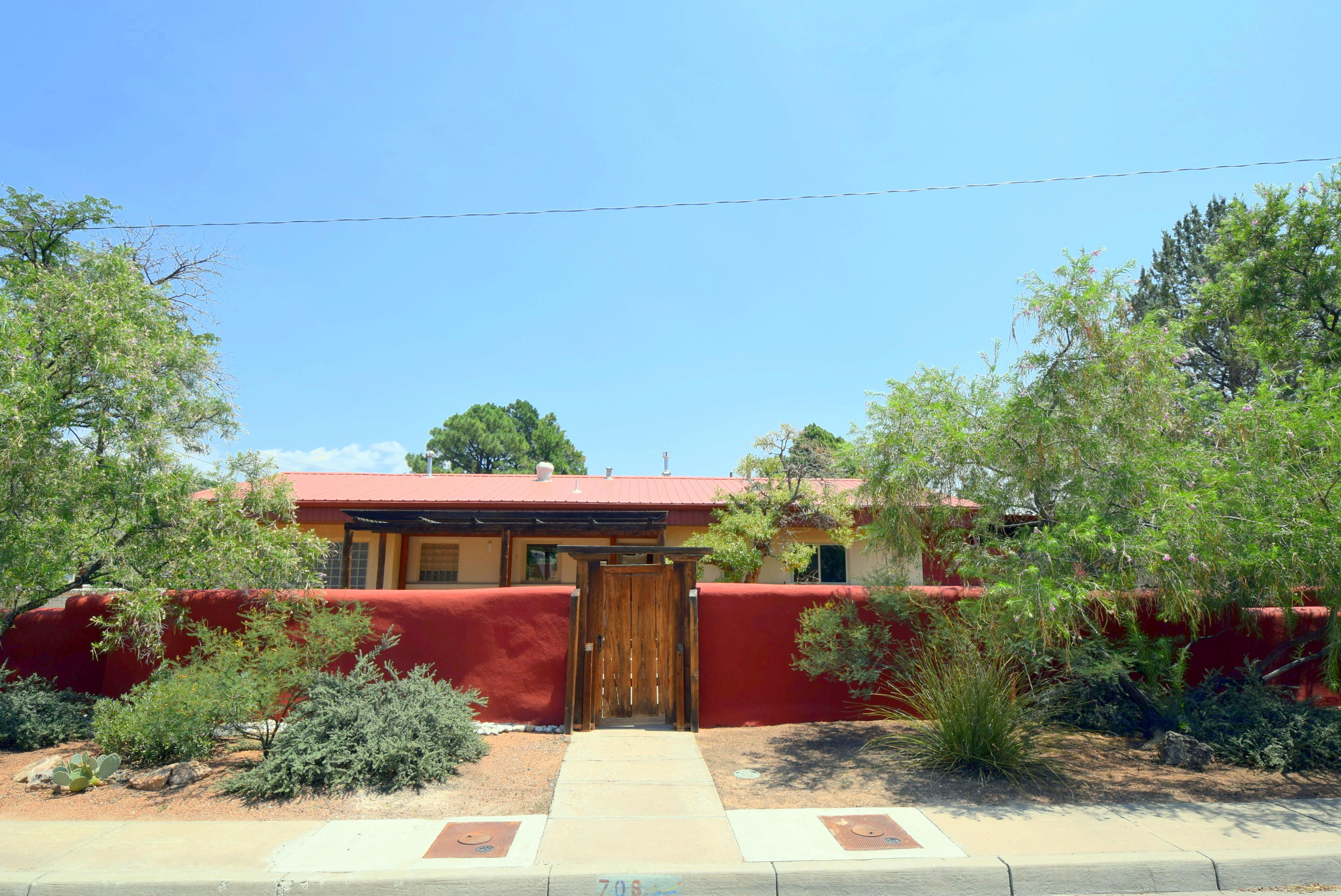 Charming home near Nob Hill, UNM, Downtown, Big I, etc.!!! Great location! Hobbyist delight! Detached studio / office 424 sq ft. Four car tandem garage with shop space, 1,164 sq. ft.! Remodeled kitchen with miles of beautiful cabinets and granite countertops! Three wood decks adjacent to living spaces and outdoor enjoyment areas!