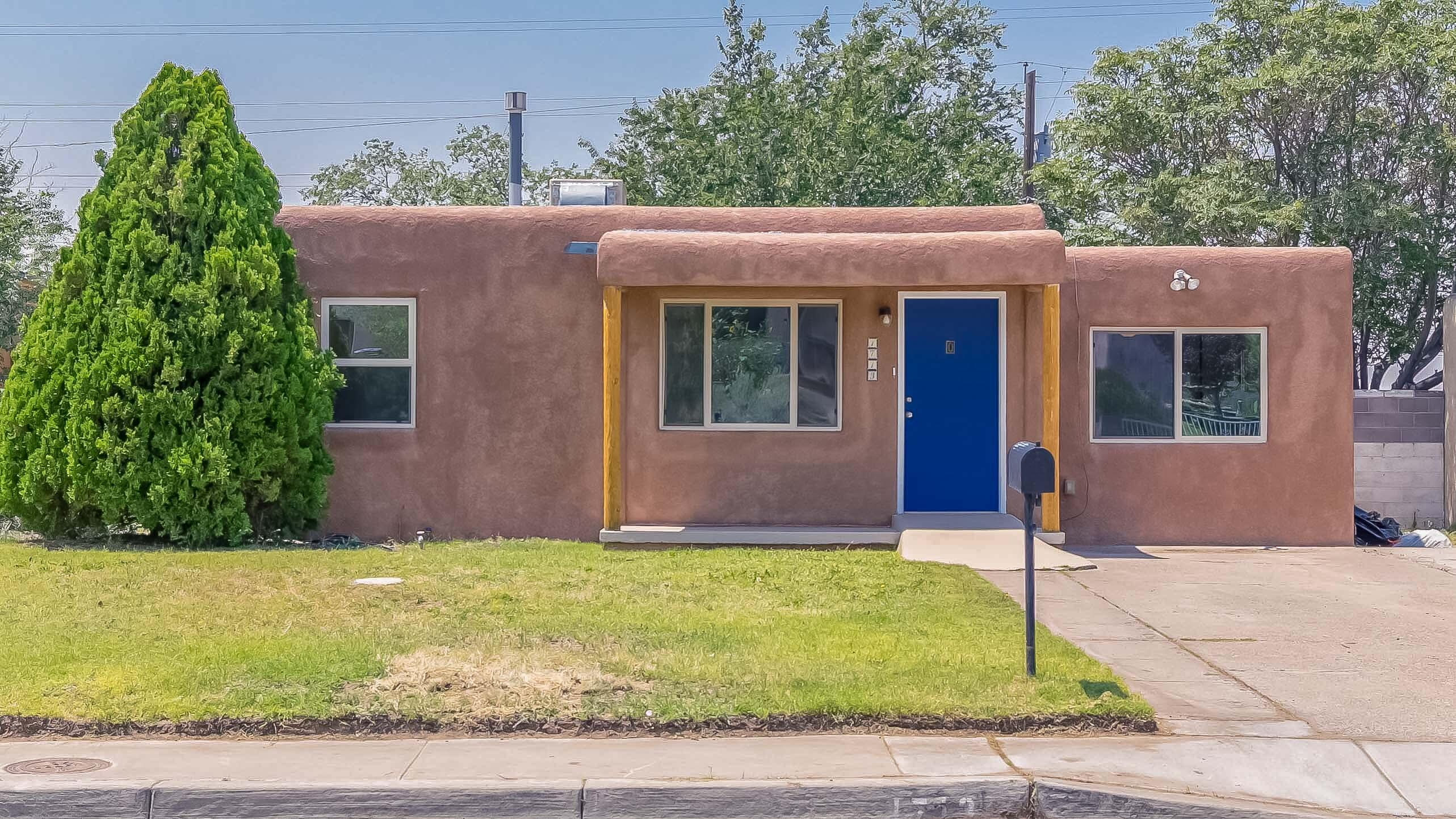 Charming Pueblo 3 bedroom home with hardwood floors and fresh paint throughout!  Classic cove ceiling in the living room.  Kitchen is spacious with refrigerator and washer/dryer included!  Upgraded, efficient windows throughout! Enjoy the outdoors in the large backyard with nice lawn and beautiful tree. Roof and Evaporative cooler replaced 2018, Stucco 2014, new water line 2016, and sewer line 2012!!!