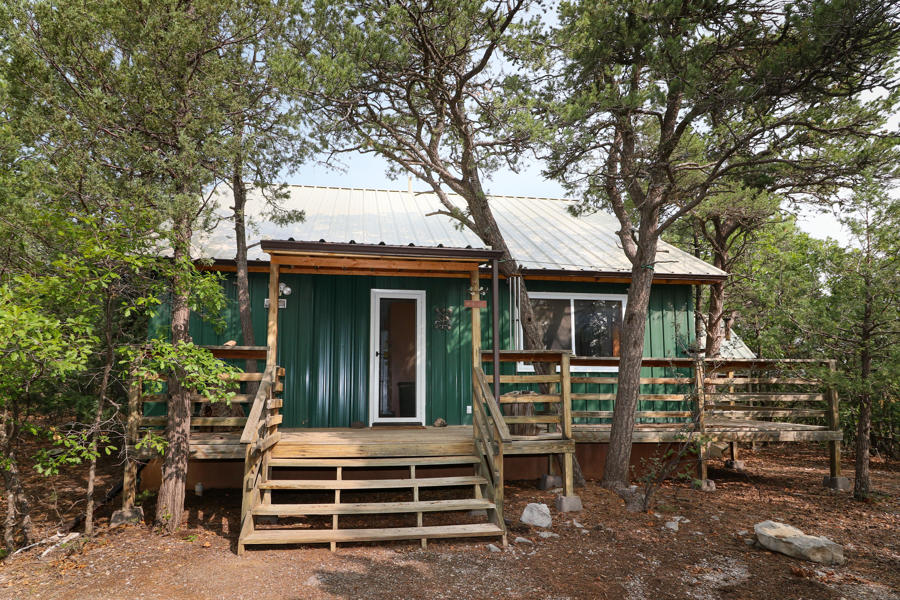 Amazing & beautiful property located in stunning Cibola National Forest.  A must-see property w/a 700 sf guest quarters, a 400 sf add'l studio, a shop w/wood stove & a pit to wk under your vehicles. Wonderful lg greenhouse & a storage shed w/loft. This property is equipped w/solar (pd for) keeping your elect costs below $10 mo. 4 owned propane tanks, 3 - 500 gallon & a 1500 gallon. A 1650-gallon water storage tank. The well is dry. Dec of 2019 a new metal roof installed on all bldgs except greenhouse.  Inspections done!  Mold Remediation done by an Industry & State Certified Company.  New water heater in Studio. Roof warranty conveys to new owner, Solar warranty conveys to new owner.  If you love to hike; abundant trailheads to explore, Pine Flat Park is just down the road. Welcome Home!