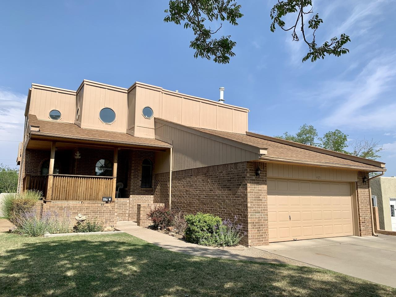 This gorgeous, energy efficient home is just 5 minutes from Nob Hill & UNM! The front covered patio welcomes you into the main level which includes an office or family room just inside the front door. The sunken living area boasts high ceilings with big windows and lots of light! There is a tiled sitting room right off of the kitchen with access to a large outdoor patio for grilling and entertaining. Relax on the balcony off of the huge 550 SqFt master bedroom. There are 2 other bedrooms on the 2nd floor. The home also features a 1116 SqFt finished basement apartment (not included in the square footage) with a separate entrance and covered patio. With R-T (Residential-Townhouse) zoning, the owners have been renting it out for decades. Also ideal for in-law quarters or short term rentals!