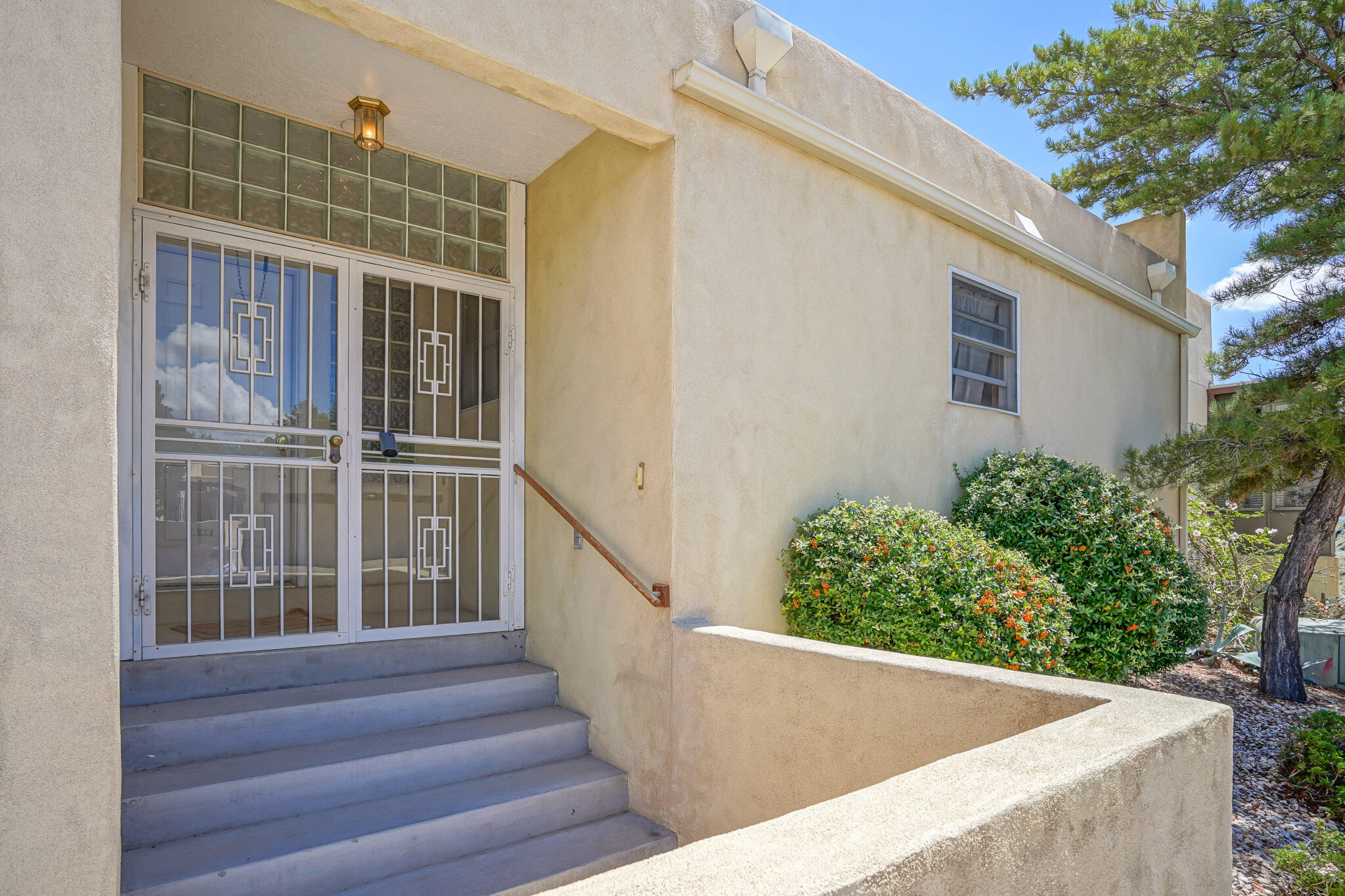 Wonderful Zero Lot line Home with a 11 by 50 foot Enclosed backyard .Home  features four bedrooms plus a Two car garage plus an additional 20 X 13 work area not in heated sq ft  Living Room has 14ft Ceilings and Clearstory windows. Original owner well cared for .Super UNM location.  Near Whole  Foods at Carlisle and the freeway I40 and I25Tennis Club close by as well as UNM North Golf Course and Altura Park , Montezuma and SmithsNewer Hot water heater with Recirculation pump.