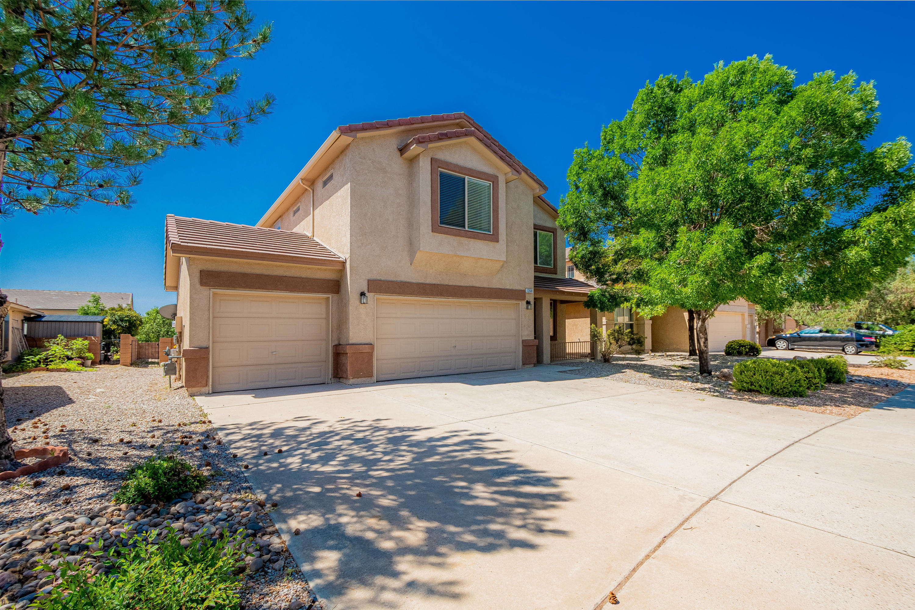 Four bedroom home in a beautiful Rio Rancho neighborhood. Surrounded by parks with a 3-car garage and multiple balconies. Wonderful investment property or family home. Comes with a Vivint Security System.
