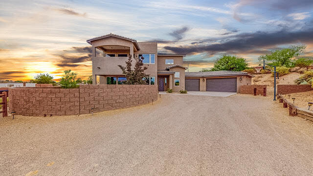 Magnificent custom built Desert Sage beauty located in the heart of Corrales on a gated 1 acre property! Home features 2,442sf with 3 bedrooms, 3 bathrooms, a loft and a 1,200sf garage! Great open living area with wood look tile floors, a built-in media center and a gas fireplace! Chefs kitchen with upgraded cabinetry, quartz countertops, custom backsplash, built-in oven, microwave, gas cooktop, large island with seating area and pantry. Family dining area right off of the kitchen! First floor in-law suite with bath and a guest bedroom! Upstairs find the loft area perfect for a quiet home office. Private owners suite hosts a balcony with stunning views and bath. Bath with dual sinks, garden tub, walk-in shower & closet! Enjoy dinners under the covered patio watching those Sandia sunsets!