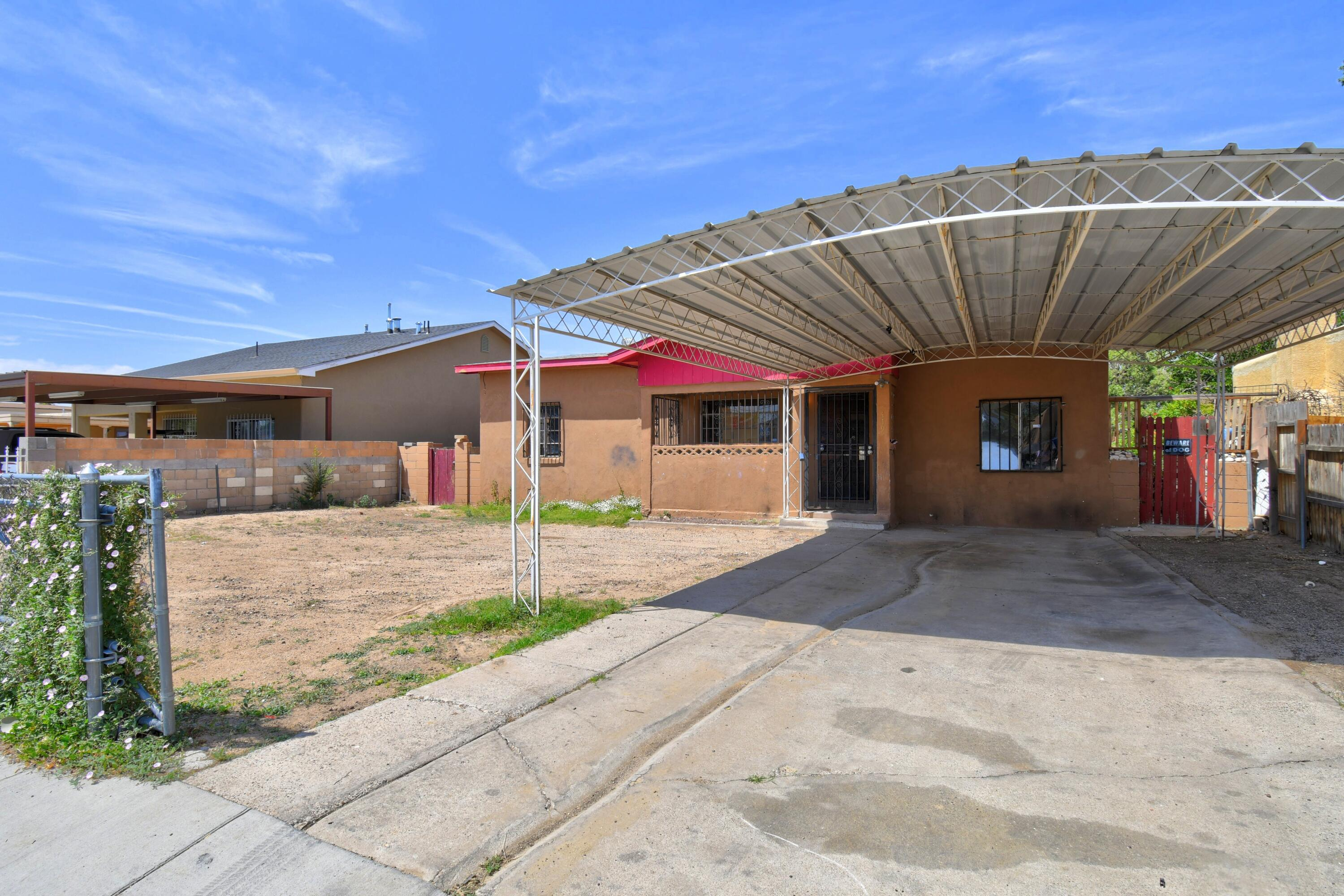 **AS-IS** Great investment opportunity! Come check out this 3 bedroom, 2 bath with 2 living spaces. Large Carport for all your toys.  The home is located down the street from La Mesa Elementary School.  Close Proximity to KAFB, I40 and many shopping areas. So much potential!  This home will not last.  Hurry and set your appointment today.