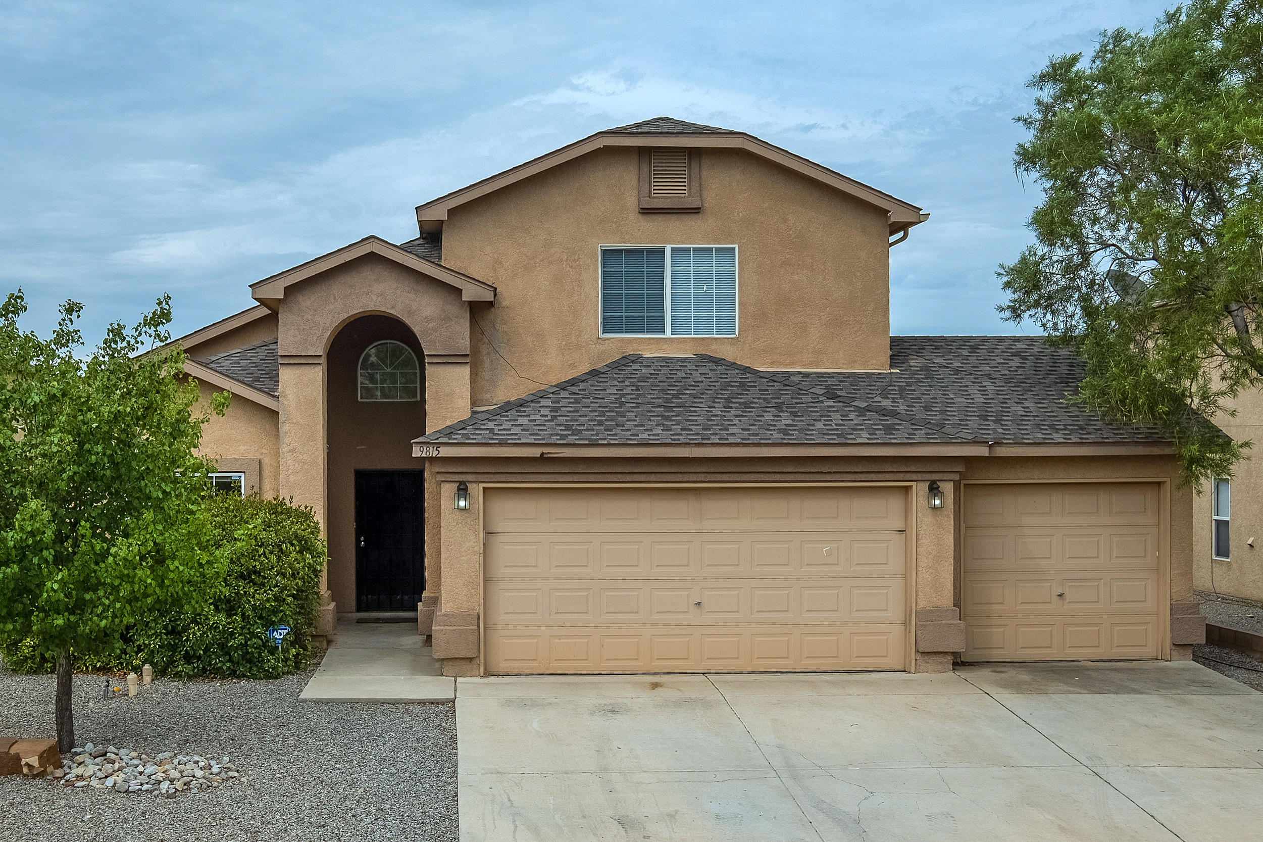 Back on the Market with a NEW Roof! Located in Sungate Estates Gated Community on a Completely Landscaped Large Corner Lot. This Home has a 3 Car Garage with Garage Openers for Both Doors and also includes a 220 Outlet. There are 2 Living Areas and a Balcony with Sandia Mountain Views. If You are Looking for 2 Living Areas, Three Bedrooms, all with Walk In Closets, Space for a Possible 4th Bedroom, 3 Bathrooms, Downstairs Owner's Suite on Extra Large Lot, then Look No Further. Make An Appointment Today to See This Home.