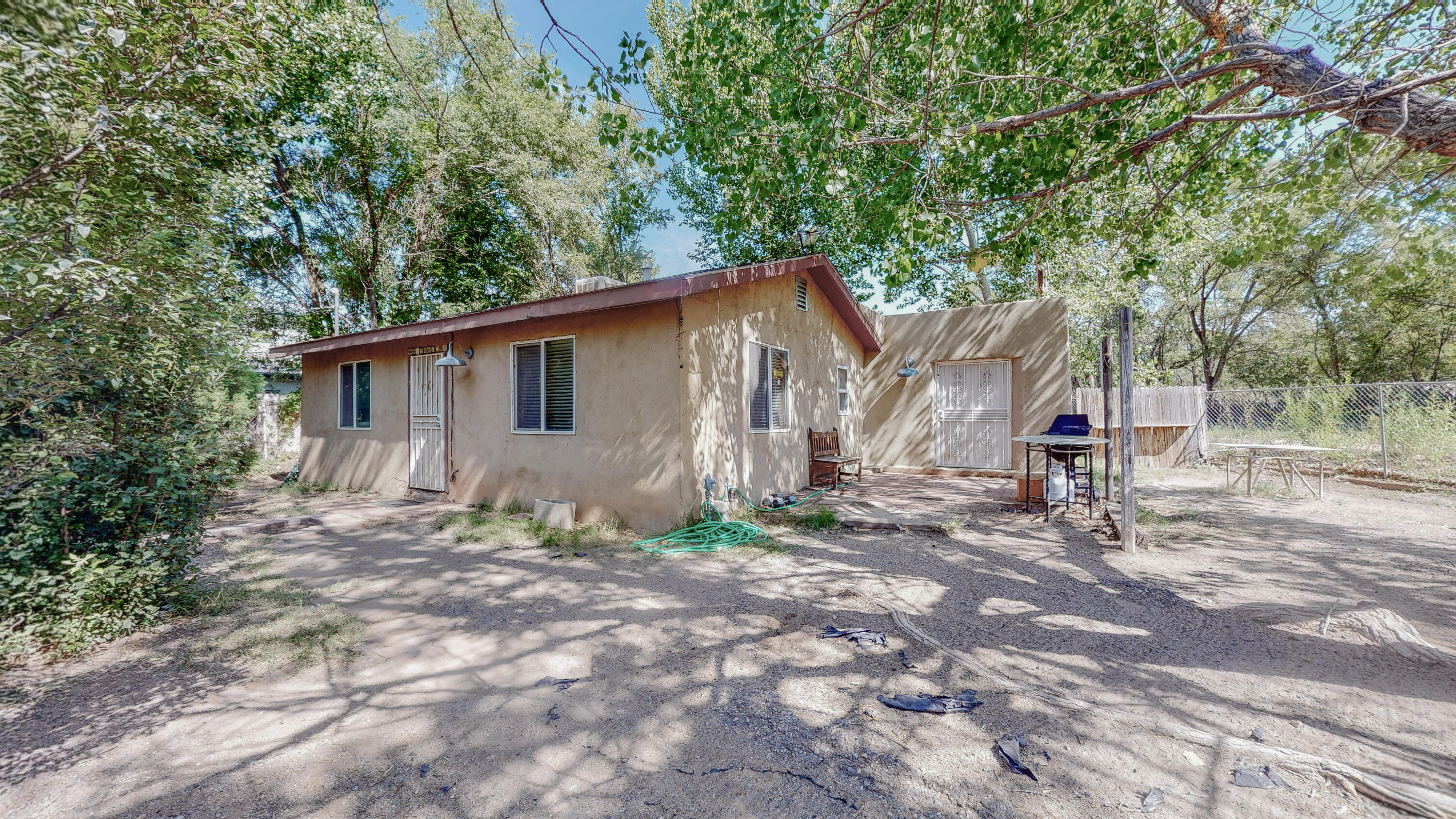This home sits in a corner lot next to the ditch bank offering you comfort and privacy. It has a spacious yard with plenty of space for growth and trees to provide shade. The master bedroom features a large space, brick floors, and french doors. Come take a look!
