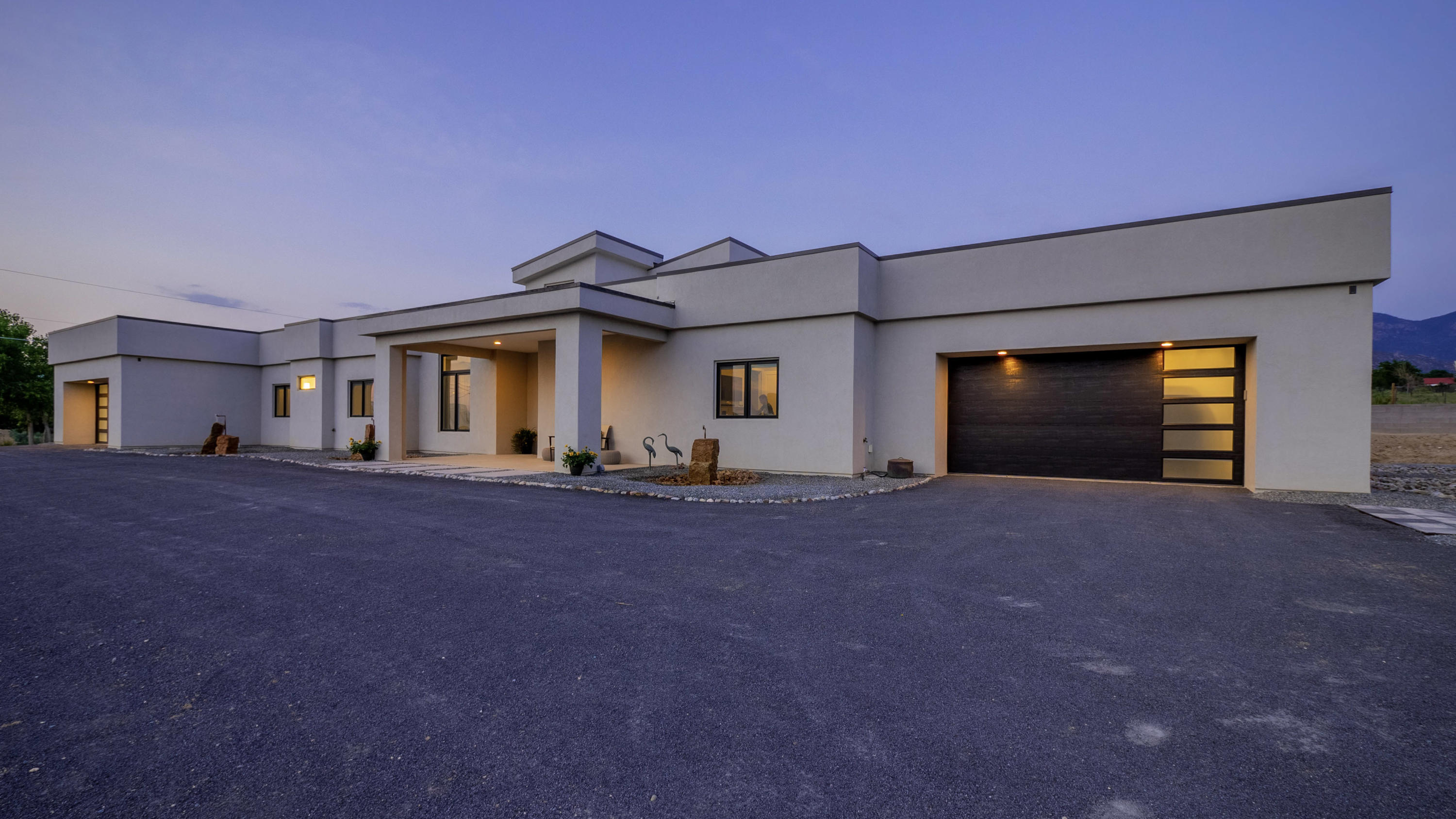 This one-of-a-kind contemporary masterpiece is located in the most desired North Albuquerque Acres located moments from hiking and biking trails, shopping, dining, and top-rated schools. This sophisticated and stylish estate sits on a premium .79-acre corner lot with stunning views of the Sandia mountains. A sprawling open floorplan welcomes you upon entry into the great room with high ceilings and a gourmet kitchen. Boasting 5 bedrooms, 4.5 baths, 6 car garage, beautiful quartz countertops, custom cabinetry, Viking appliances, and charming modern fixtures. Enjoy the luxurious master suite with a relaxing fireplace, garden tub, radiant heated floors, and a large walk-in closet. Additionally, the attached 1,100 SF casita features an elegant master suite, full kitchen w/walk in pantry,