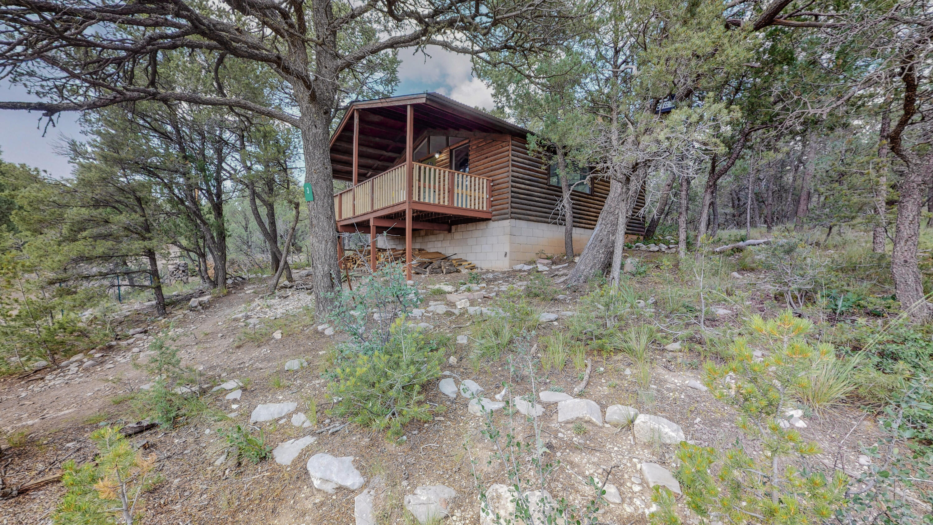Fantasize about getting away to a private cabin on 2.4 acres of serene, forested land this weekend? YOU CAN!  Secluded, accessible and affordable, this cabin has been meticulously rebuilt. Updated electrical panel, new flooring, bathroom remodel, wood stove for plenty of heat, and a renovated kitchen area complete with custom wood countertop. Enjoy coffee or a night cap from your west facing balcony, cozy up with a book or explore the woods. Cabin is on Septic System and water source is hauled water with brand new tank and pump. All permits have been obtained for the rebuild. Owner is also selling adjacent lot and home at 2 Swallow, and both could be purchased and combined to make this your ultimate move to the East Mountains. Would also make a trendy Airbnb! 1k Allowance to finish shower!