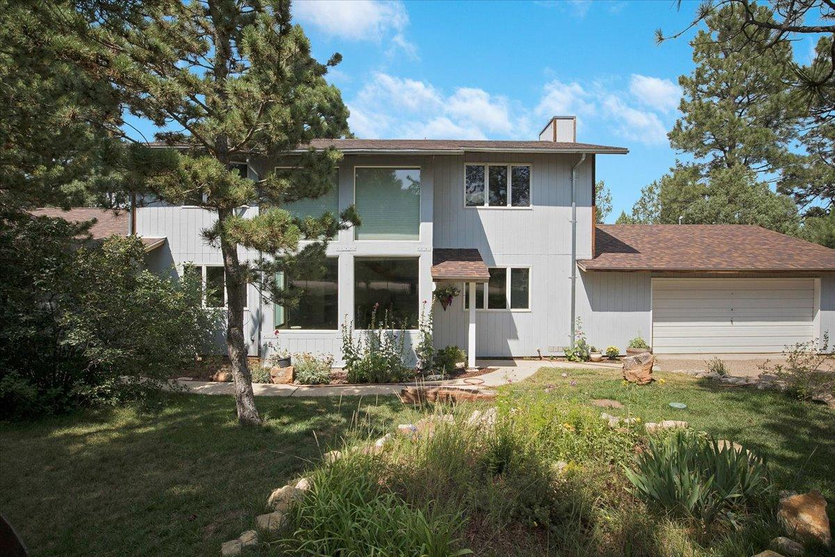Private Mountain Living, just 20 minutes from Albuquerque. Tucked away among the pines, this spacious home features 4 bedrooms, with the primary suite on the main level, offering walk-in closet, huge shower, and private deck. Large kitchen with granite counters, breakfast bar, and stainless steel appliances, plus dining room. Main level features 2 living areas, 1 with a wood stove, and upstairs, includes 3 bedrooms, a full bathroom, loft area perfect for office or game room, and access to the upper balcony. 2 car finished garage. Don't let this one pass you by, come take a look and fall in love! NEW ROOF