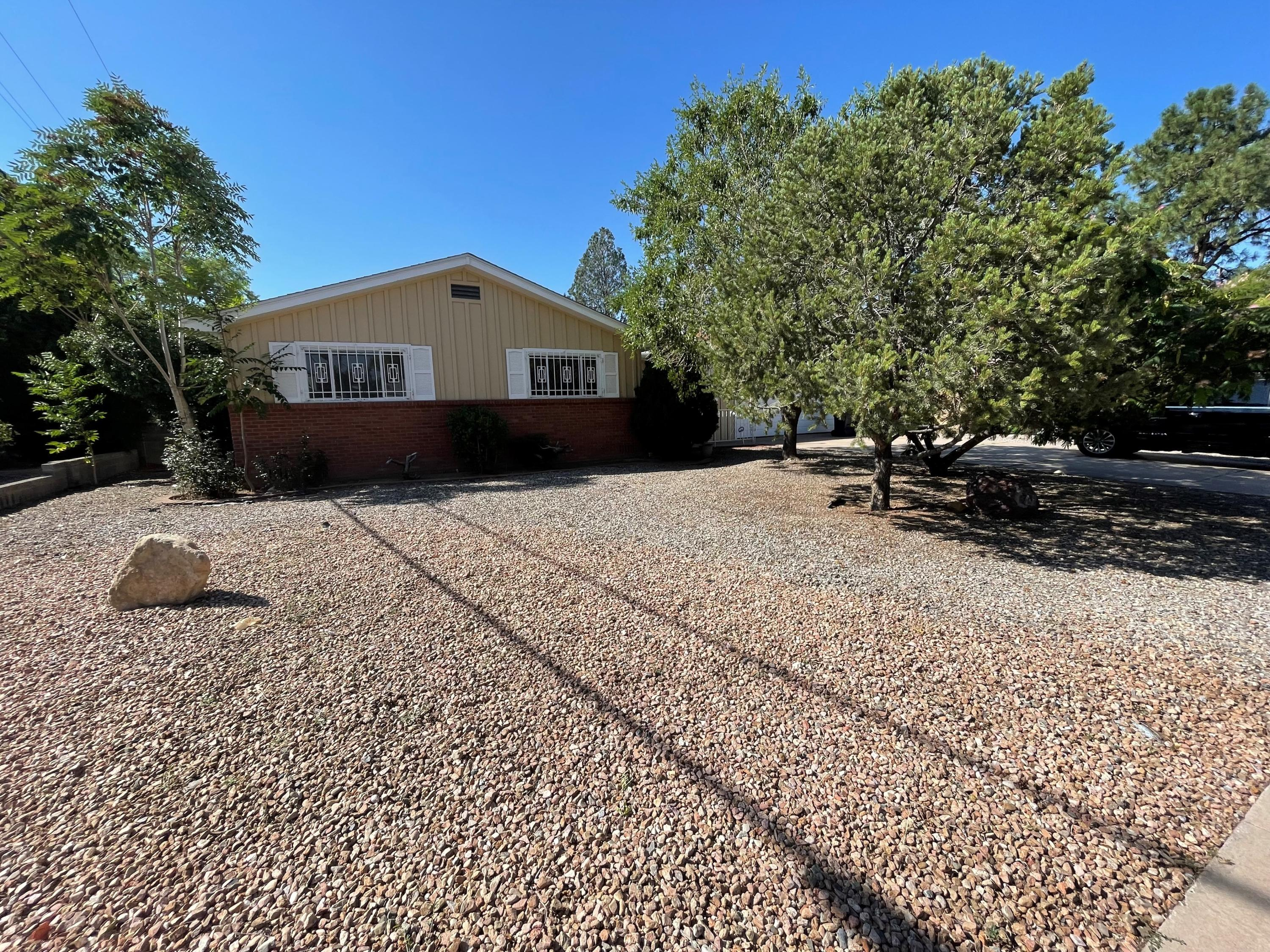 This home is located in the heart of Albuquerque, north of uptown.  Front yard is low maintenance landscaped and the backyard is huge with grass and trees and covered patio.  Original hardwood floors, roof and furnace were replaced 6 years ago.