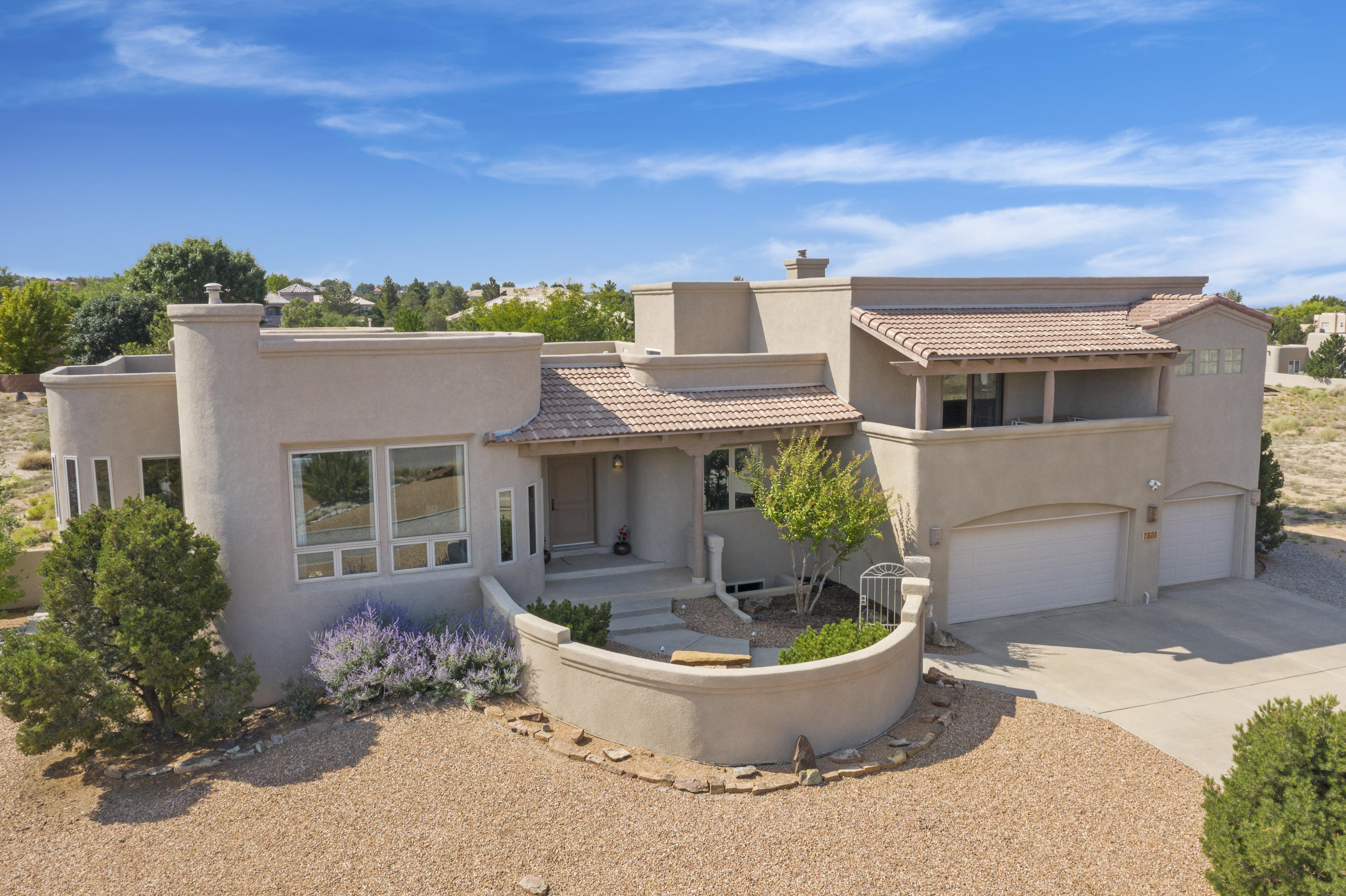 Incredible Sandia Mtn views, enjoy colorful sunrises, sunsets & Balloon Fiesta! Casual elegance abounds in this 4BDR/4BA/3CG custom home.  Great room w/kiva fireplace, soaring ceilings & windows showcasing stunning mtn views! Gourmet kitchen w/beautiful cabinetry, solid surface countertops, island & sunny bkfst nook w/views!  Private master suite w/dual sink vanity, jetted tub, sep shower, walk-in closet & balcony to enjoy your morning coffee & relax at sunset. Huge lower level living space w/great room, 2-way fireplace, game room, wet bar to entertain family & friends! Circular drive, front courtyard, amazing outdoor living space w/covered patio, wood burning fireplace, built-in grill, grass, trees & garden area!  3CG has storage, 50 amp for elec car, 220,built-in workspace.