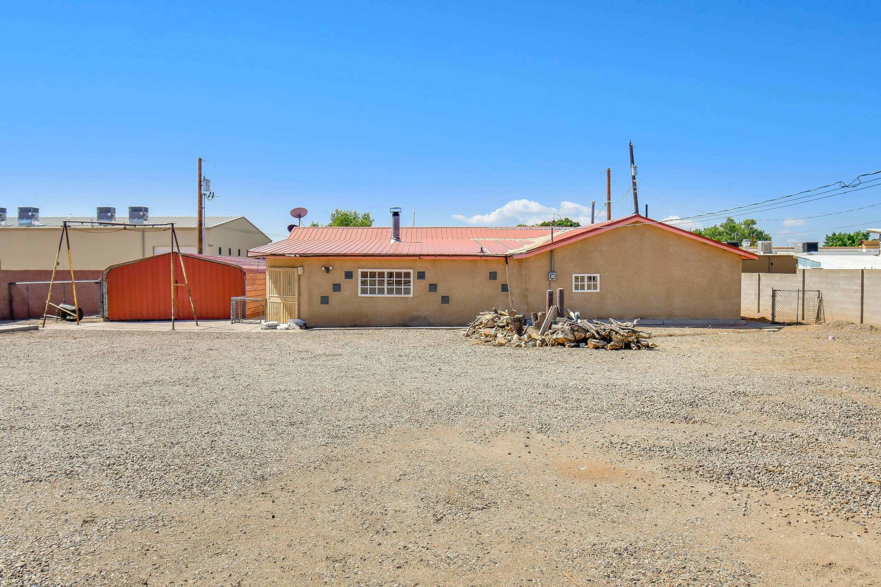 Great opportunity to own a nice piece of property in the heart of town.  This home sits on a half acre lot with gated and walled privacy.  Home is spacious and will need some updating.  Additional workshop buildings on the property are large and offer numerous possibilities.  Come see this special property today.